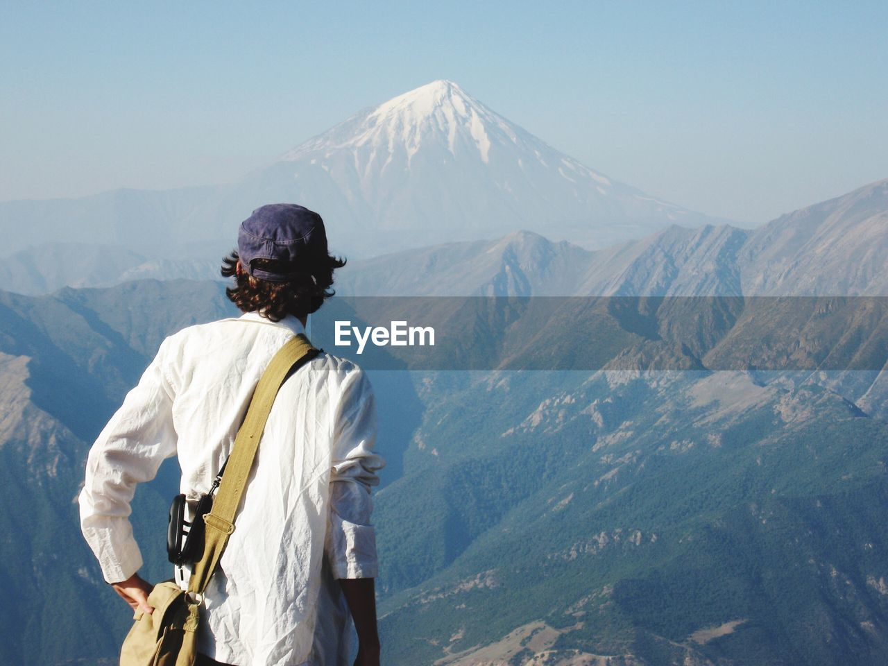 Rear View Of Man Looking At Mount Damavand Against Sky