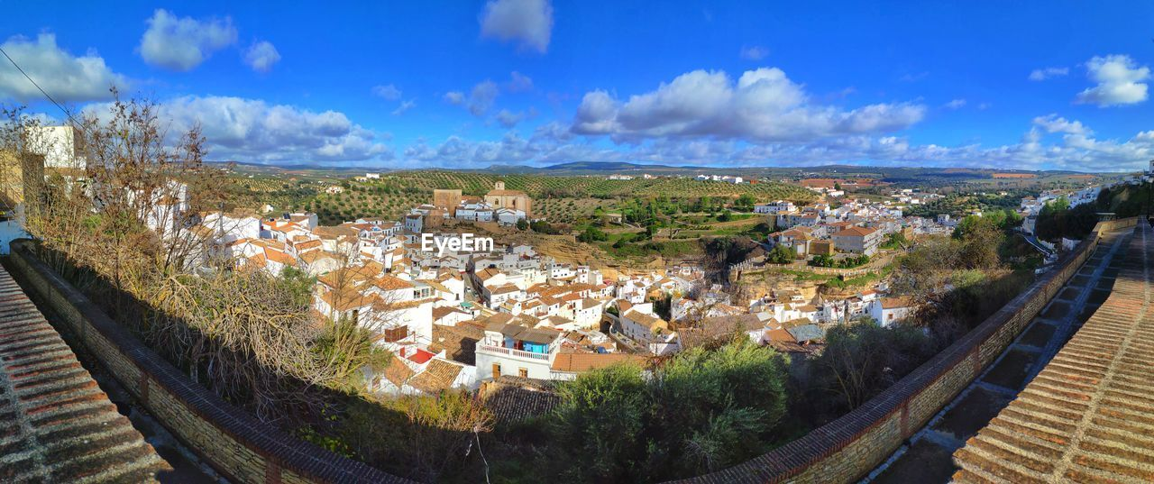 architecture, built structure, building exterior, city, sky, building, residential district, nature, cloud - sky, high angle view, panoramic, day, town, plant, landscape, tree, environment, no people, house, outdoors, cityscape, townscape