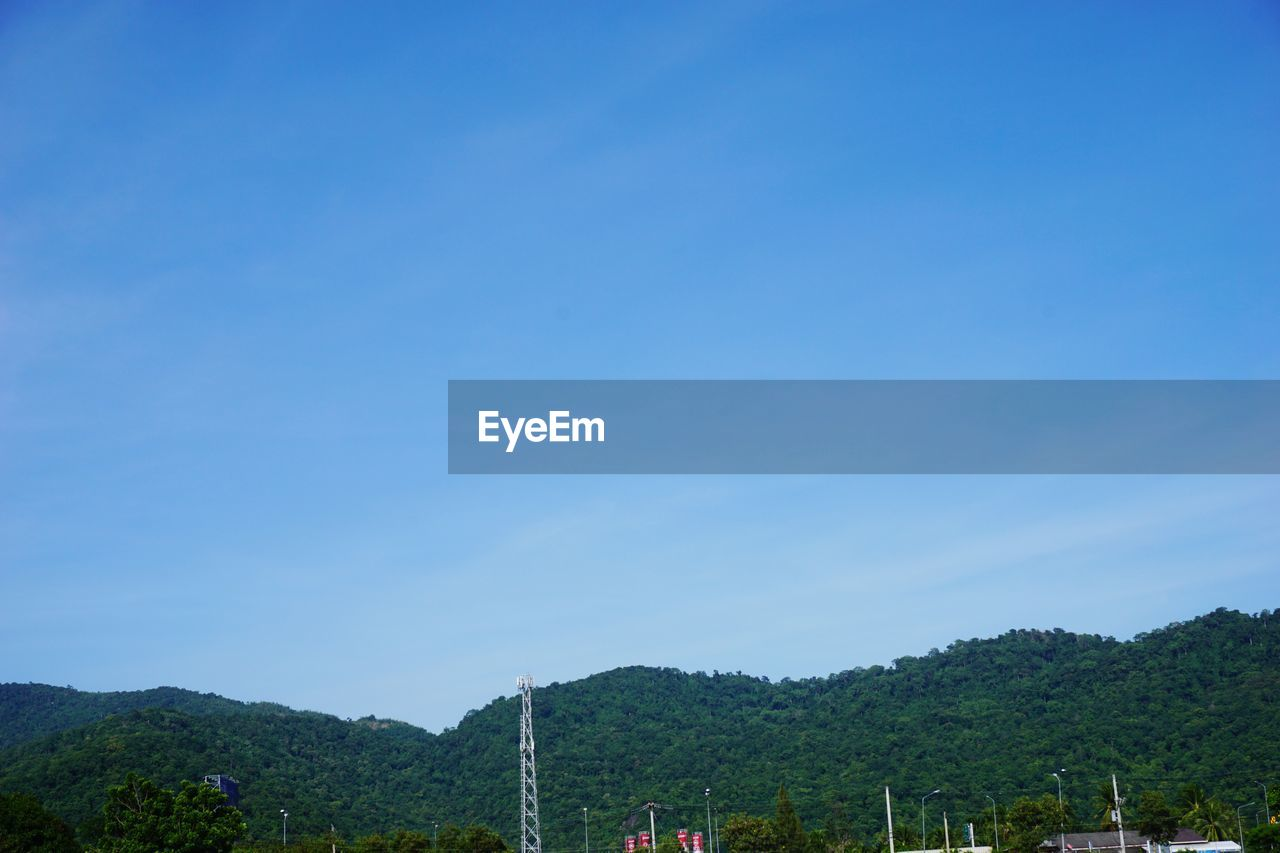 sky, mountain, tree, beauty in nature, copy space, nature, plant, blue, scenics - nature, tranquility, tranquil scene, no people, mountain range, day, non-urban scene, environment, outdoors, green color, idyllic, growth