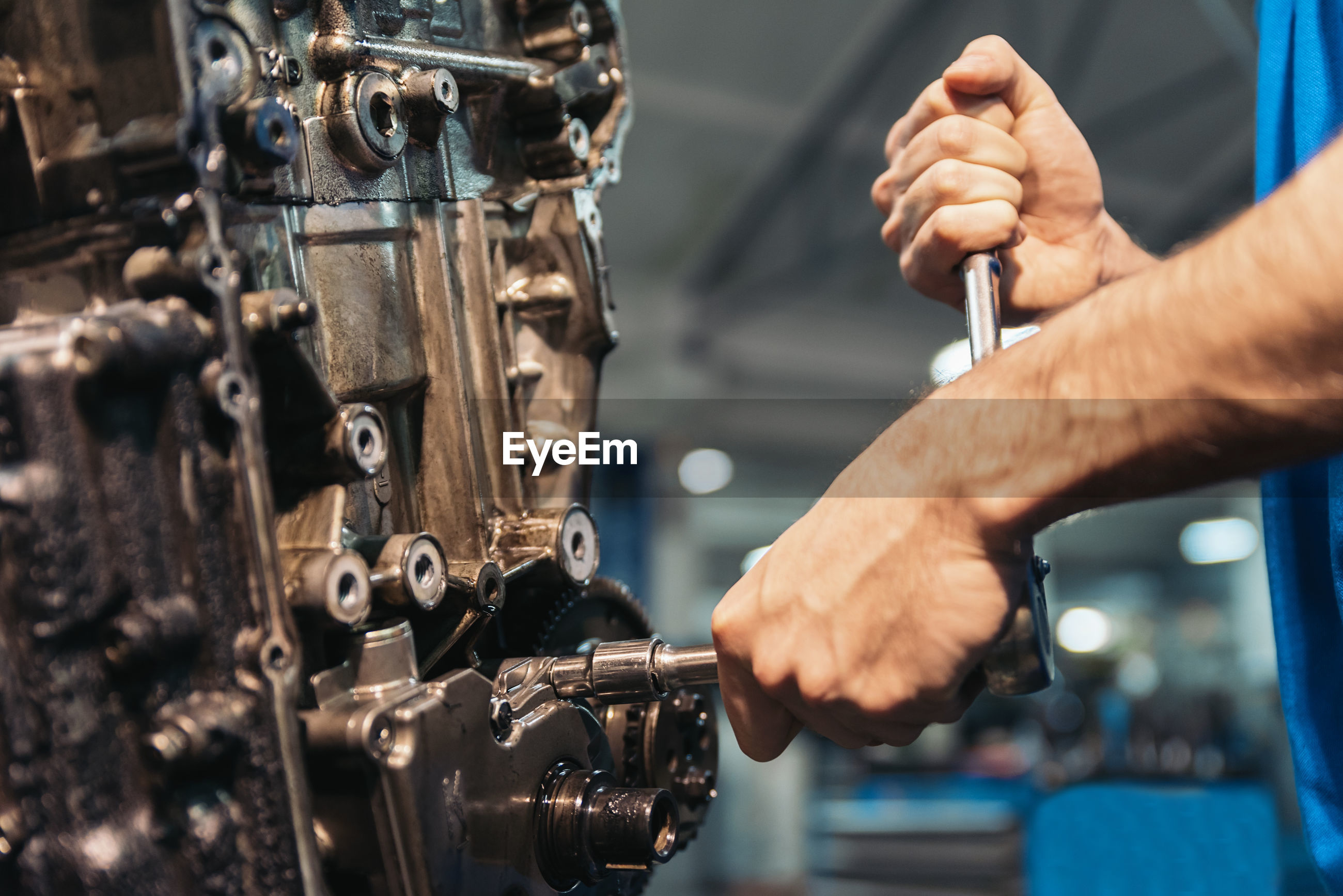 Close-up of man working in garage