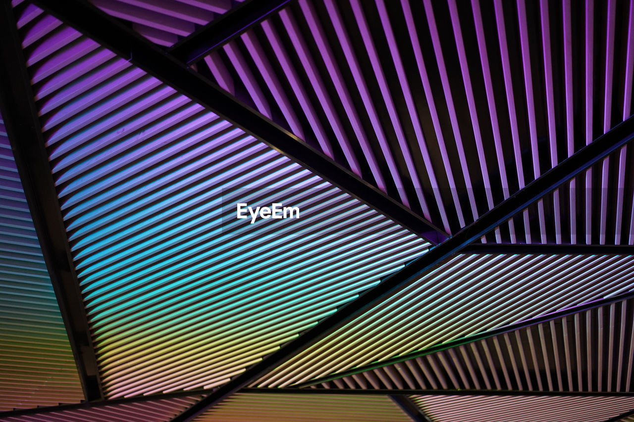 pattern, full frame, backgrounds, no people, indoors, built structure, architecture, low angle view, ceiling, striped, day, textured, metal, multi colored, roof, close-up, repetition, design, security, corrugated