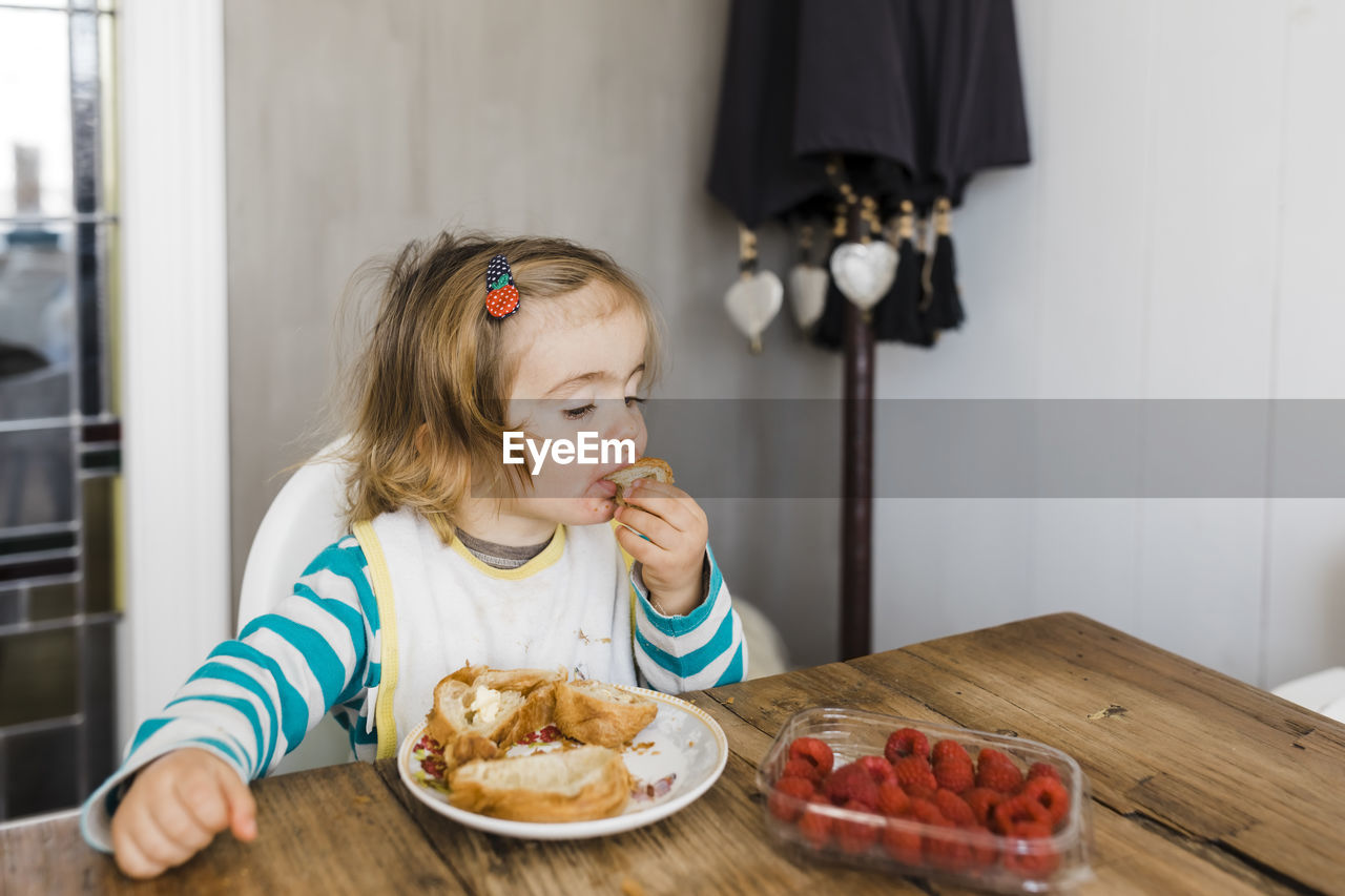 food, food and drink, child, one person, table, real people, childhood, healthy eating, indoors, freshness, home interior, lifestyles, girls, innocence, eating, sitting, females, women, breakfast