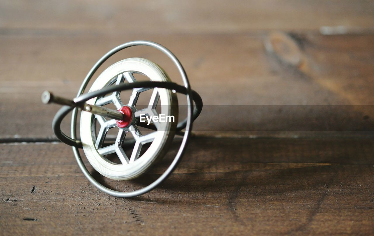 Close-up of gyroscope on wooden table