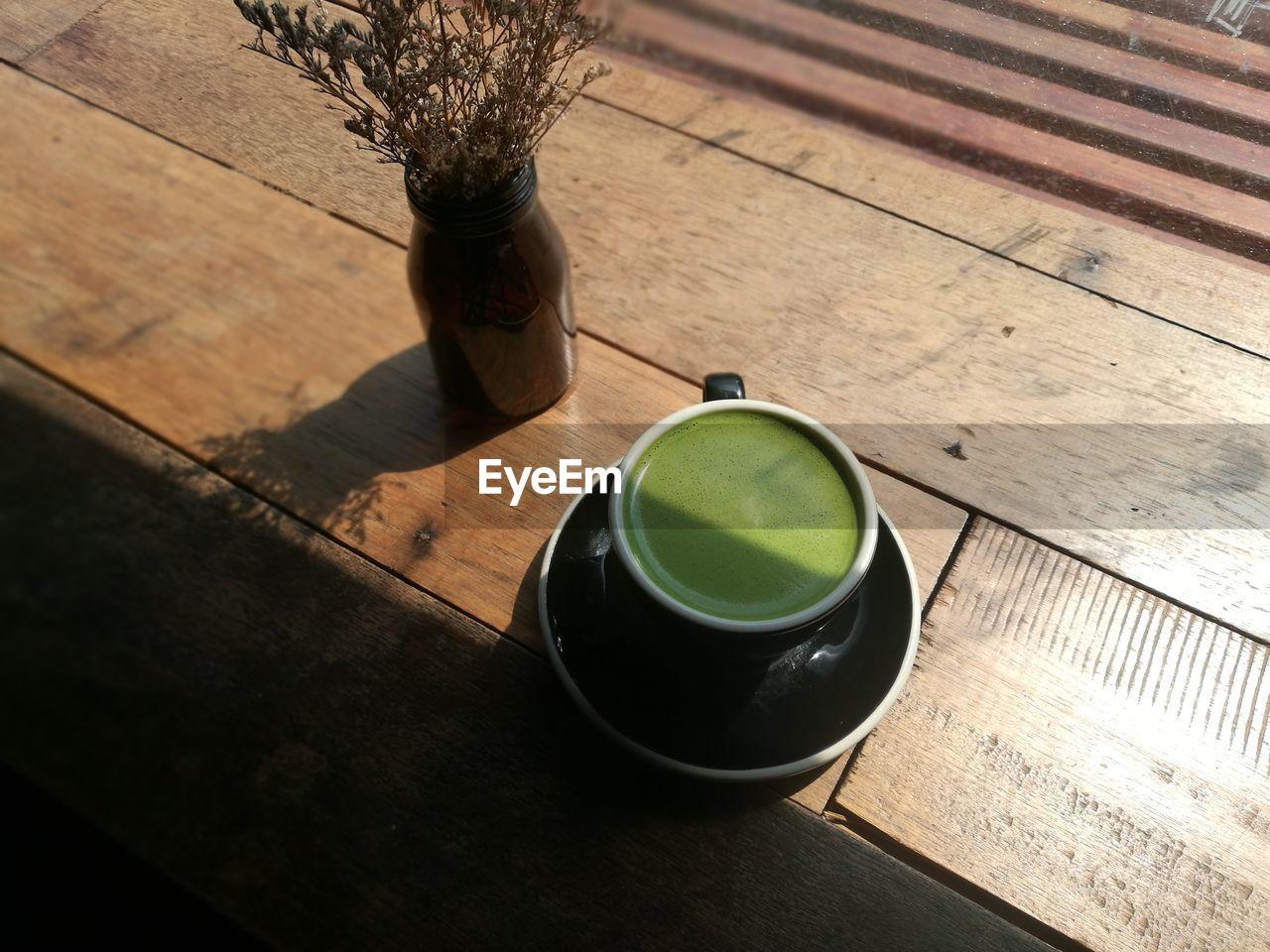 High angle view of matcha tea on table