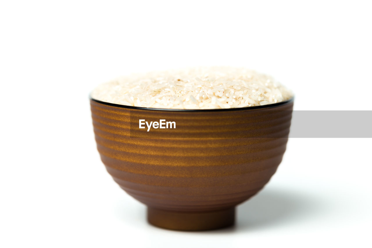 Close-Up Of Rice In Bowl Against White Background