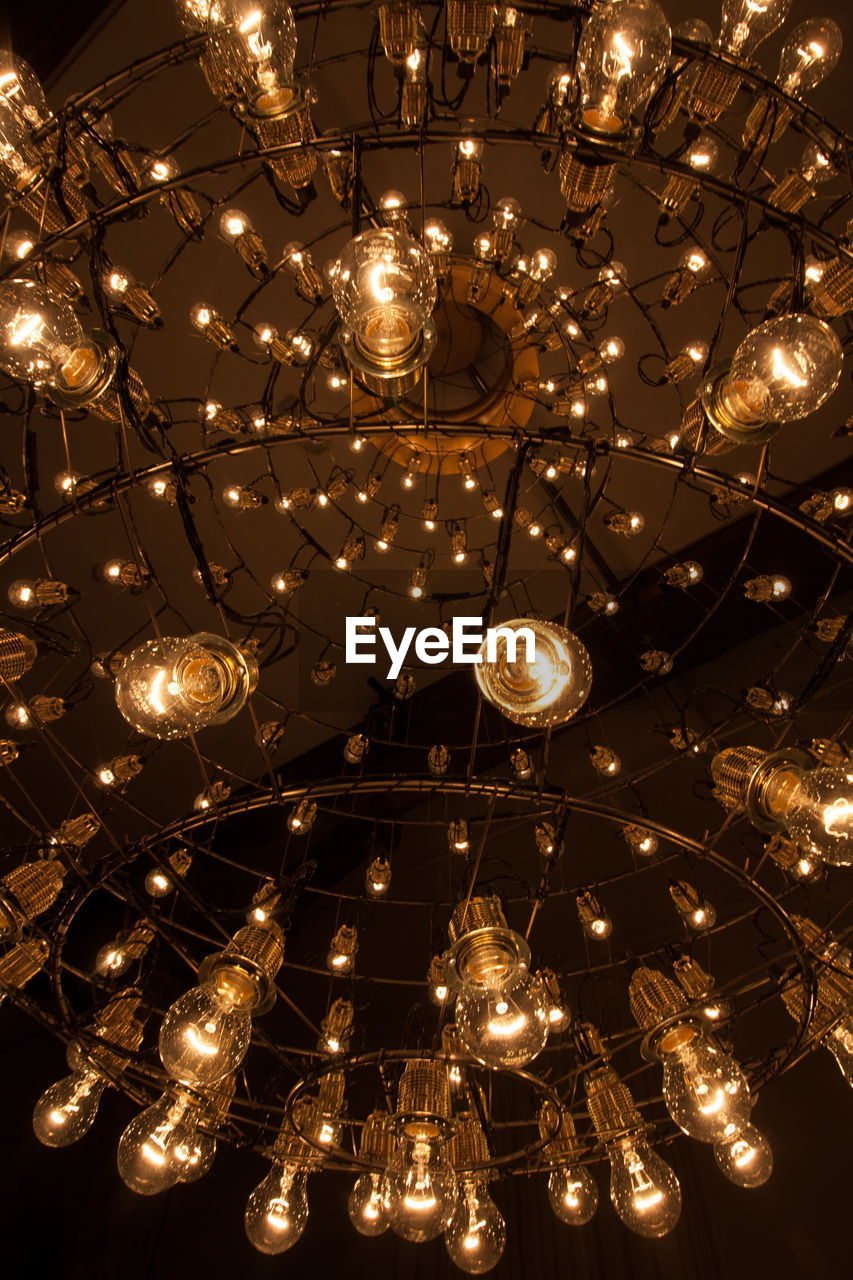 illuminated, lighting equipment, decoration, hanging, low angle view, light, large group of objects, celebration, electricity, no people, glowing, indoors, night, abundance, ceiling, electric light, event, light bulb, electric lamp, backgrounds, ornate, luxury