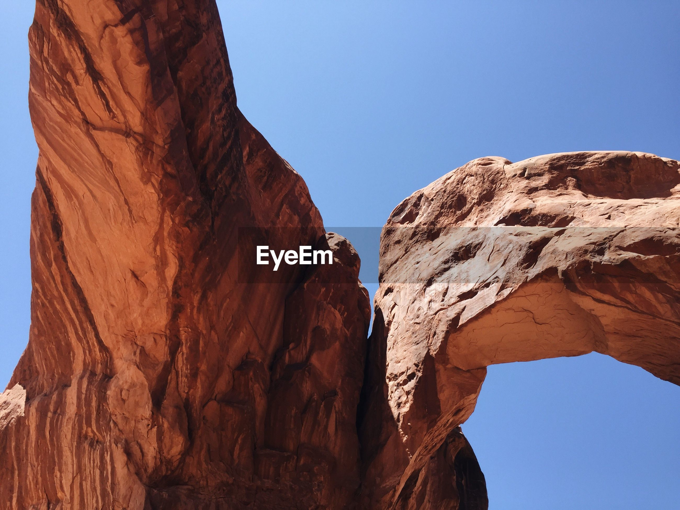Rock formation against clear blue sky at arches national park