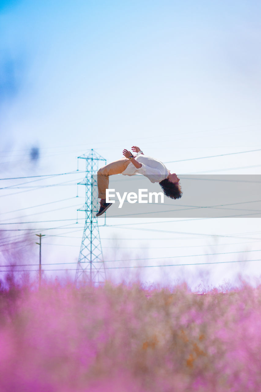 Woman Juping Against Clear Sky