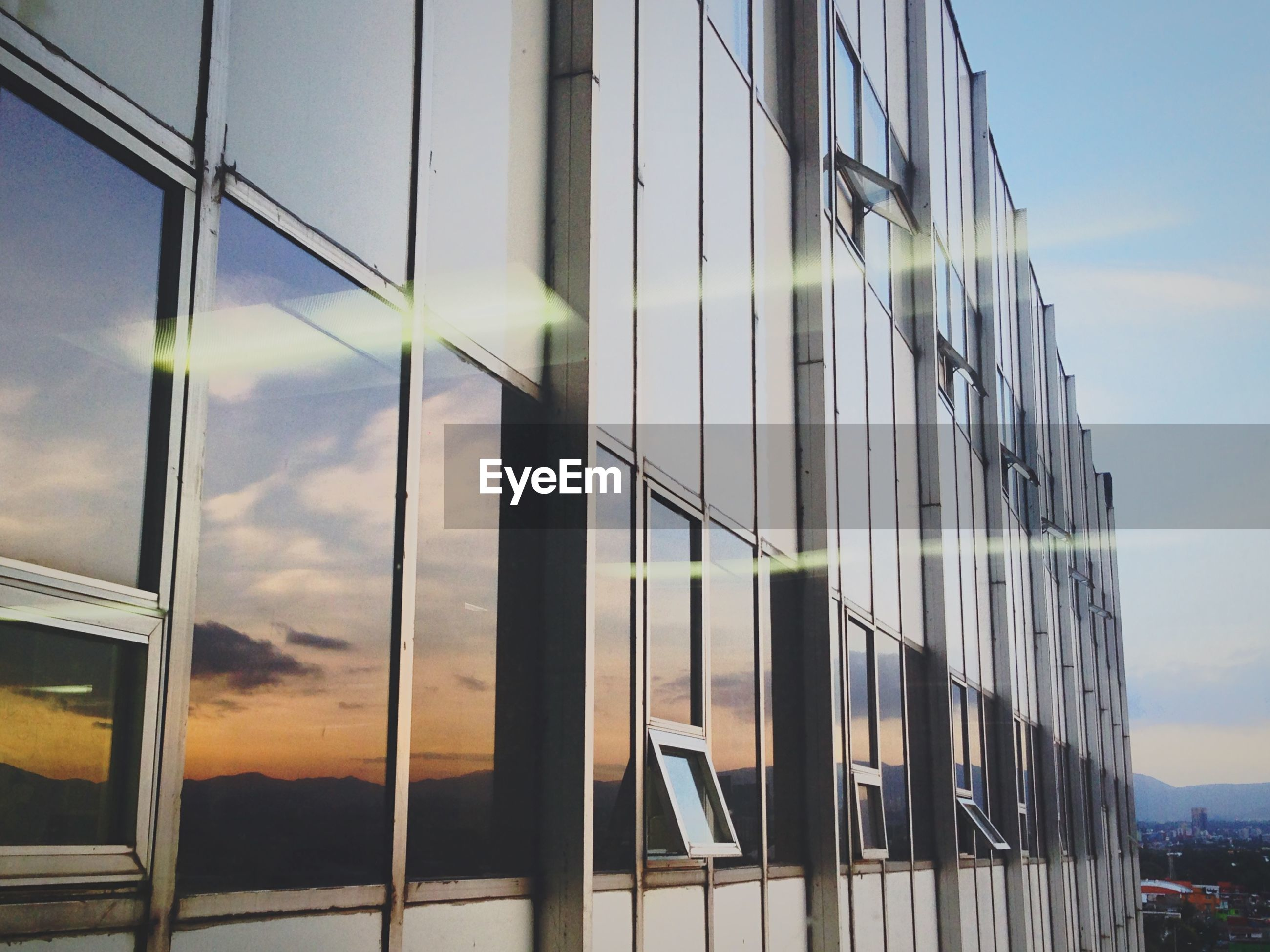 architecture, built structure, building exterior, low angle view, glass - material, window, sky, modern, reflection, building, office building, city, sunlight, glass, transparent, day, no people, outdoors, cloud - sky, cloud