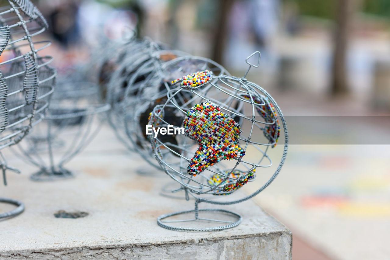 Close-up of metallic globe on table