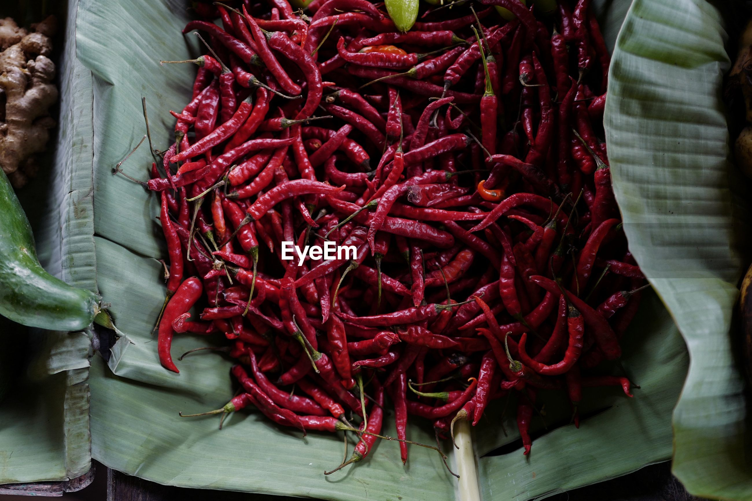 HIGH ANGLE VIEW OF RED CHILI PEPPERS FOR SALE AT MARKET