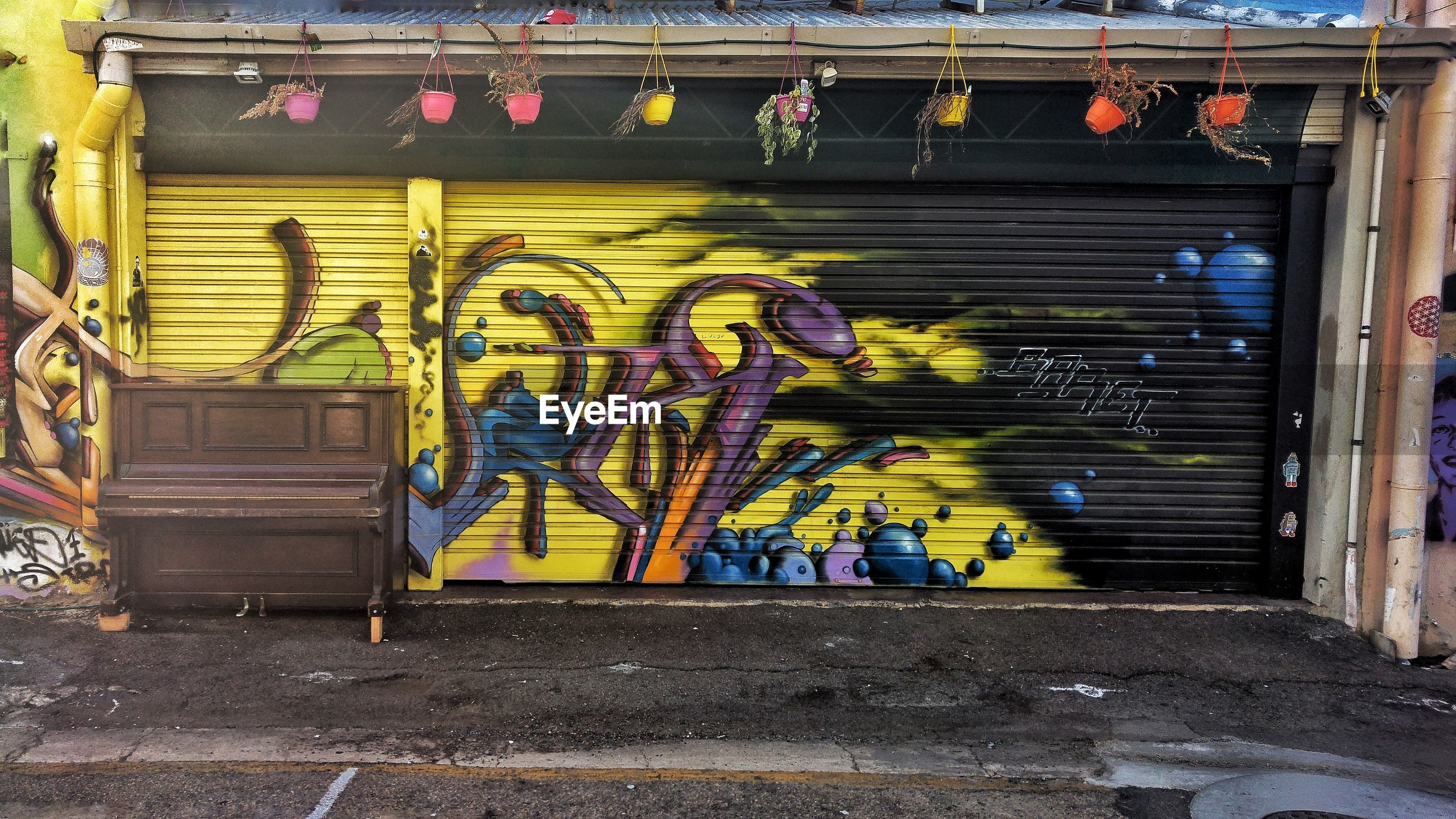 graffiti, built structure, architecture, no people, day, shutter, building exterior, outdoors, yellow, close-up