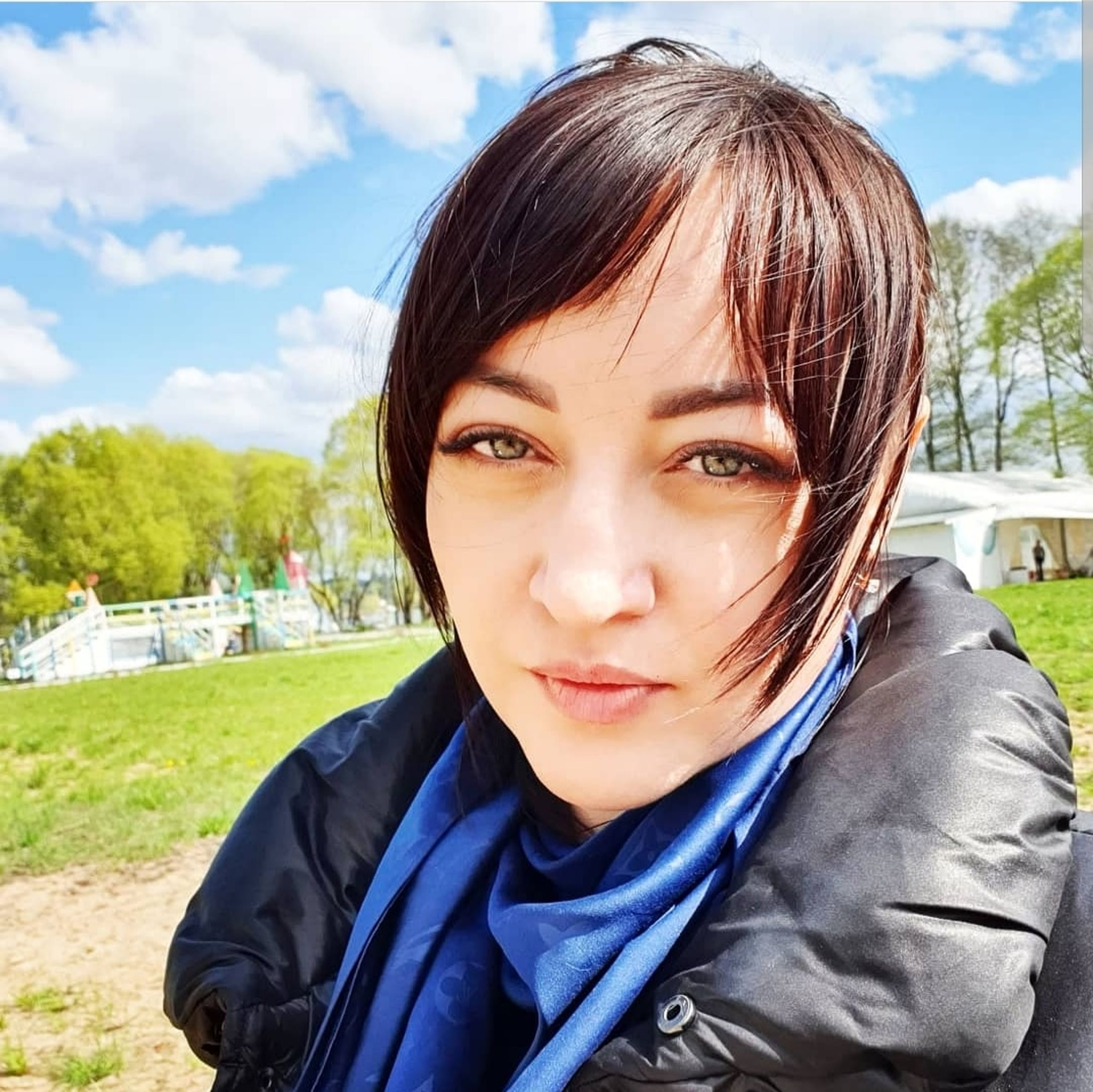 portrait, one person, looking at camera, real people, young adult, headshot, lifestyles, front view, nature, day, young women, close-up, sky, cloud - sky, leisure activity, women, sunlight, focus on foreground, outdoors, hairstyle, bangs, beautiful woman, contemplation