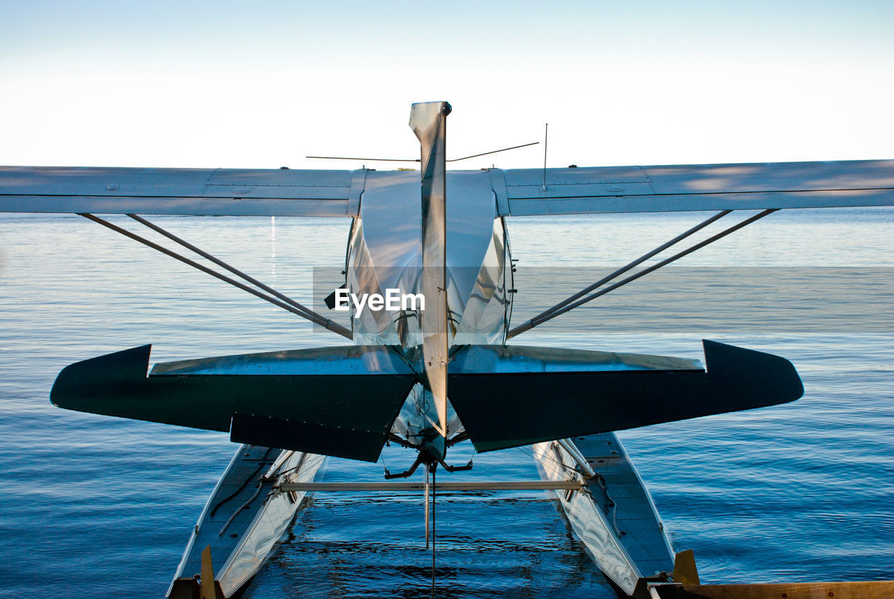 sky, transportation, mode of transportation, water, no people, nature, sea, nautical vessel, day, air vehicle, blue, airplane, outdoors, sunlight, travel, beauty in nature, motion, metal, clear sky