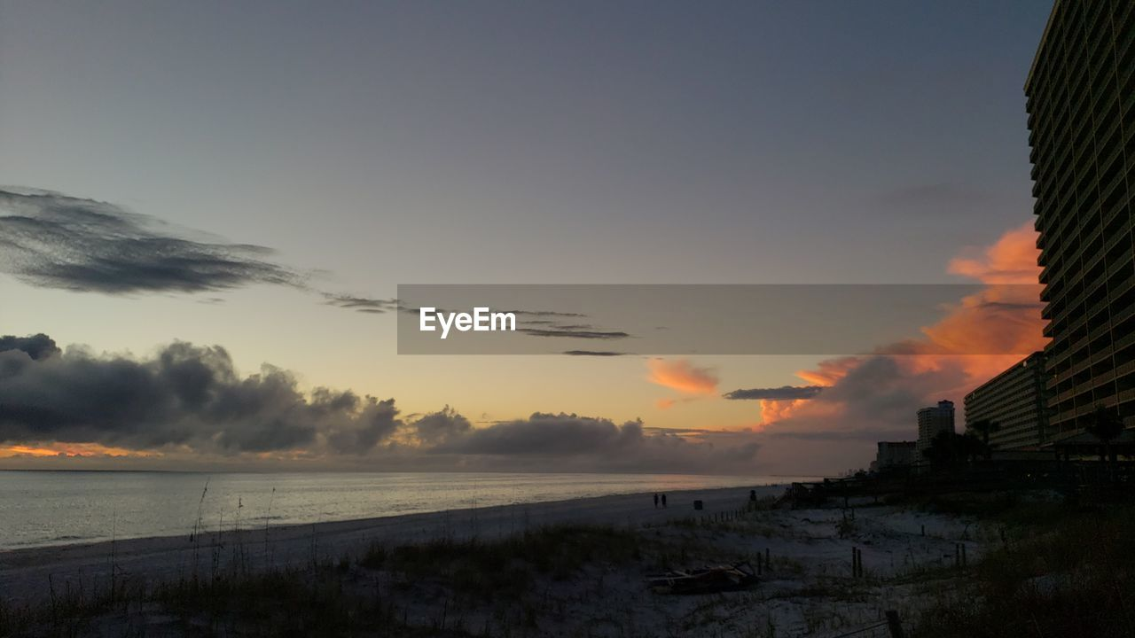 sky, sunset, water, sea, cloud - sky, scenics - nature, nature, architecture, beauty in nature, built structure, no people, building exterior, orange color, tranquility, beach, outdoors, land, tranquil scene, building
