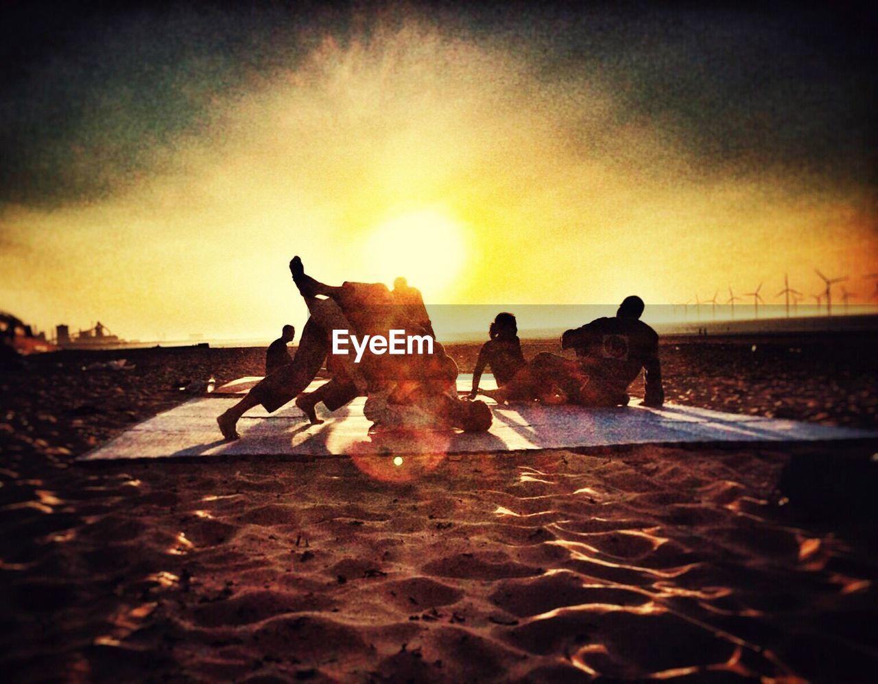 sunset, real people, men, silhouette, domestic animals, outdoors, sand, sky, nature, mammal, clear sky, day, adult, people