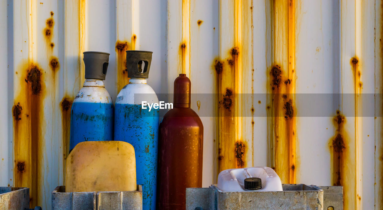 CLOSE-UP OF OLD BOTTLES IN CONTAINER