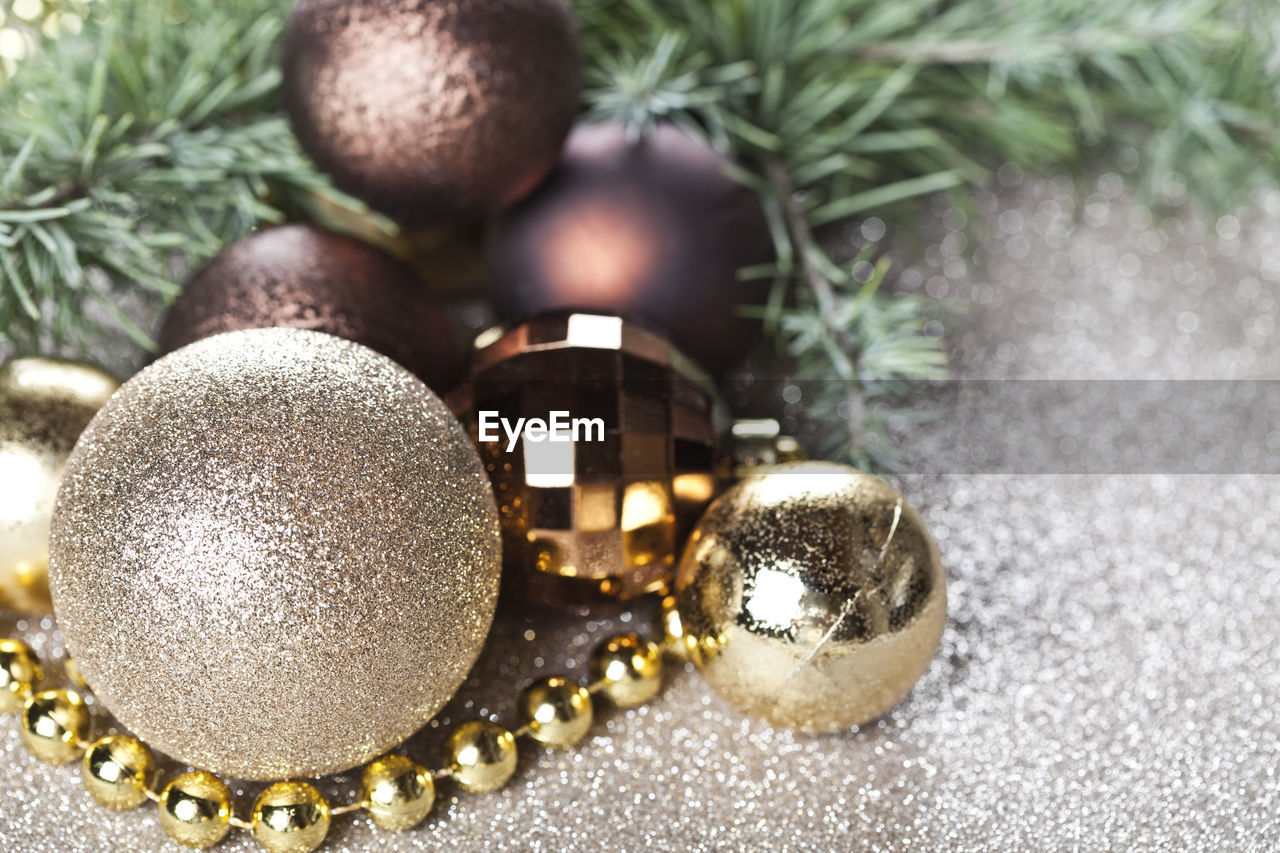 christmas decoration, christmas, christmas ornament, holiday, celebration, decoration, sphere, close-up, indoors, celebration event, christmas tree, event, gold colored, no people, still life, shiny, holiday - event, illuminated, tree, ornate, luxury, silver colored