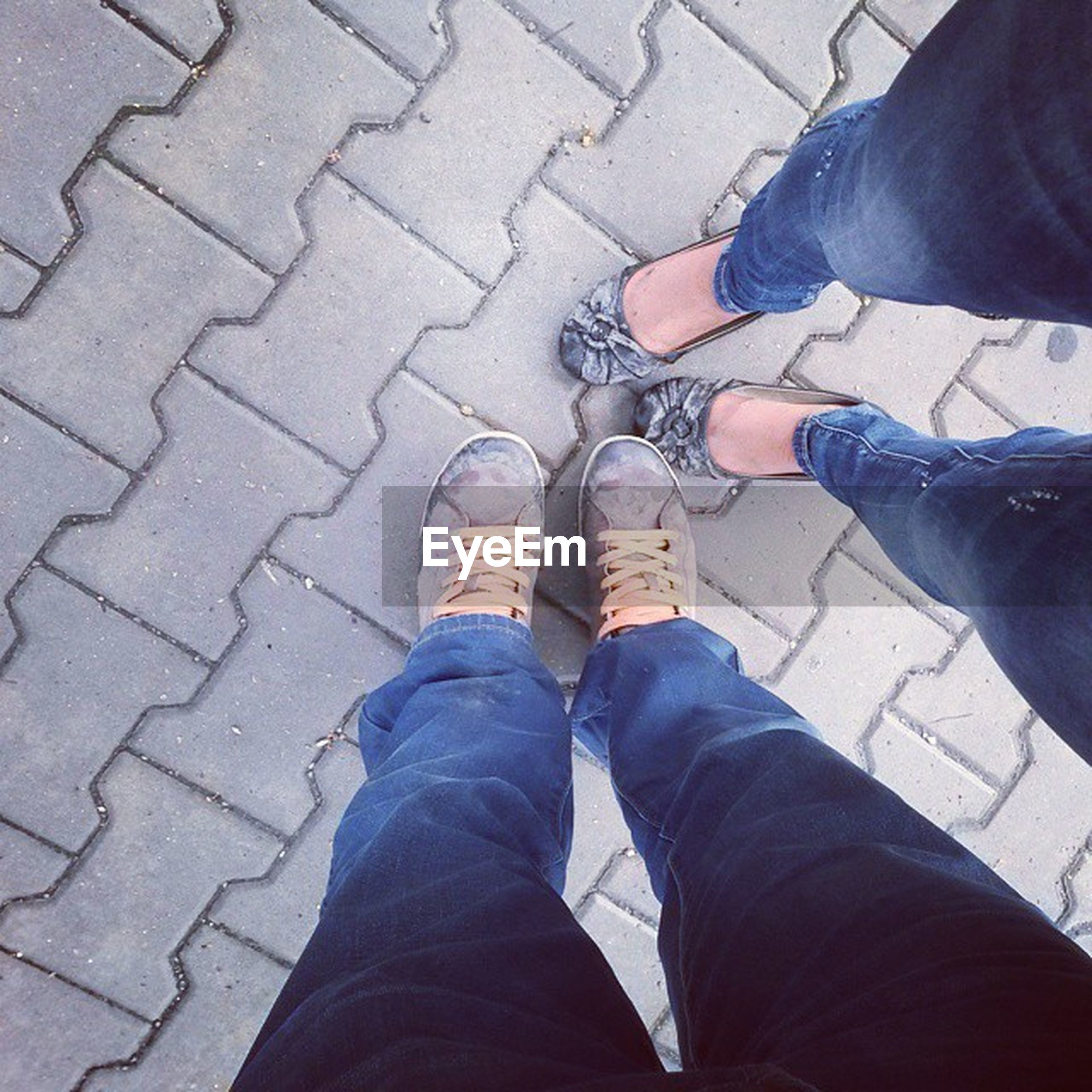 low section, person, lifestyles, men, shoe, standing, personal perspective, leisure activity, jeans, human foot, high angle view, casual clothing, togetherness, unrecognizable person, footwear