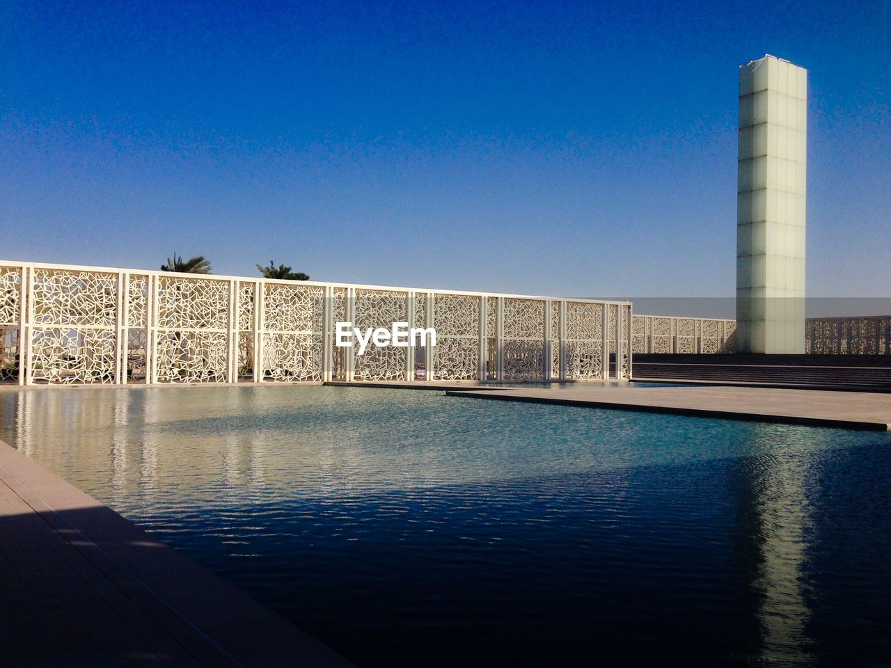 built structure, architecture, blue, building exterior, clear sky, water, reflection, no people, outdoors, travel destinations, day, sky