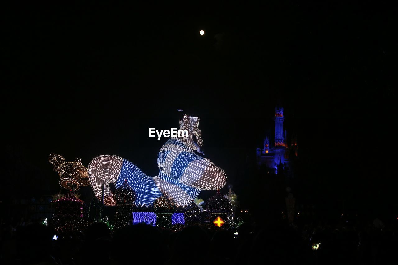 night, illuminated, sky, architecture, moon, copy space, art and craft, representation, sculpture, no people, built structure, christmas, statue, nature, human representation, christmas decoration, building exterior, celebration
