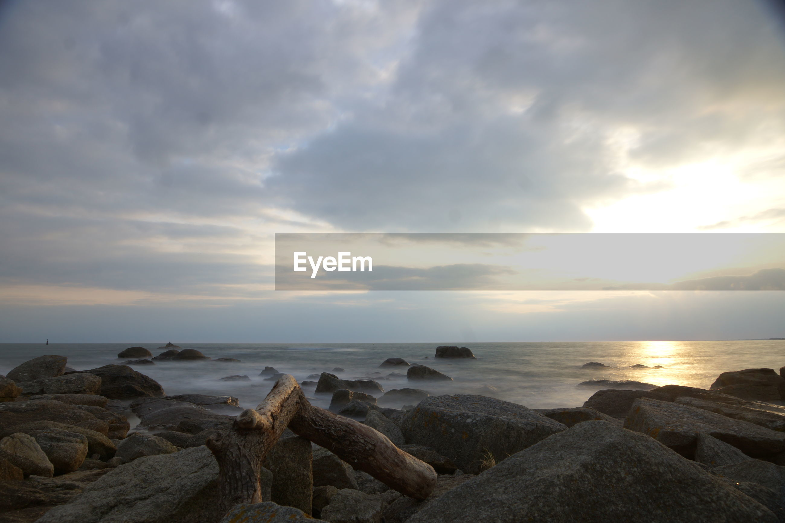 water, sea, rock - object, sky, horizon over water, scenics, sunset, tranquil scene, beauty in nature, tranquility, cloud - sky, shore, nature, beach, idyllic, rock formation, rock, stone - object, sun, cloud