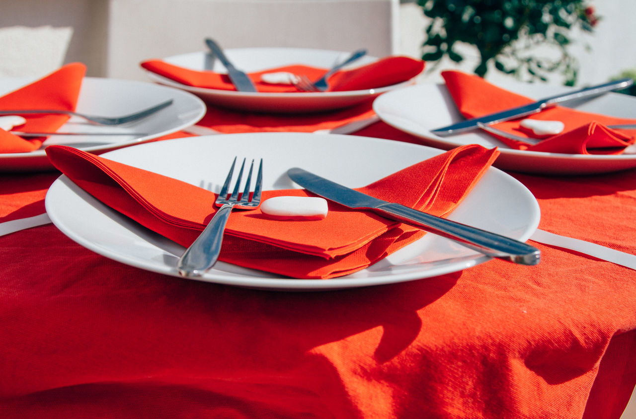 Plates arranged on table during sunny day