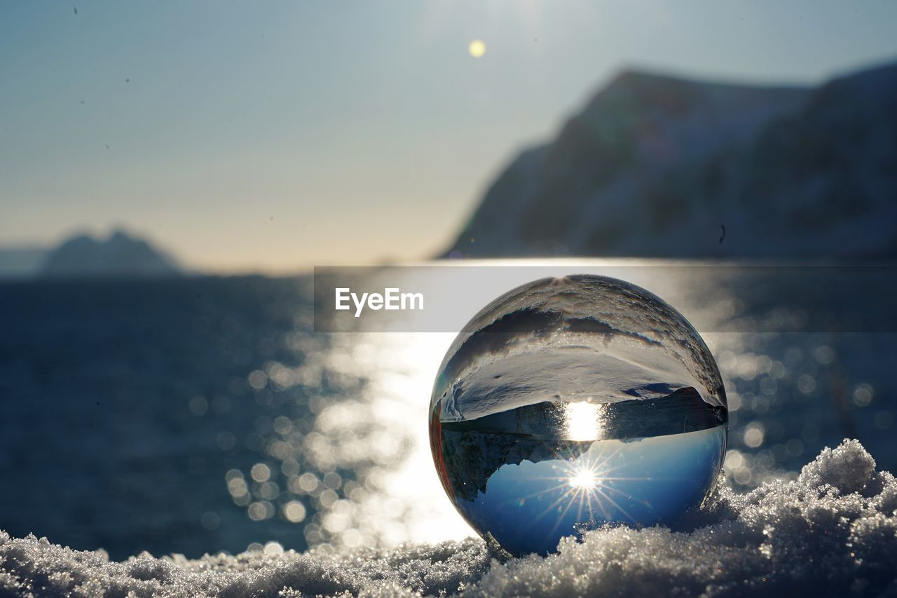 sphere, reflection, glass - material, nature, water, transparent, sky, scenics - nature, crystal ball, focus on foreground, tranquility, close-up, tranquil scene, beauty in nature, sunlight, ball, no people, outdoors, sea