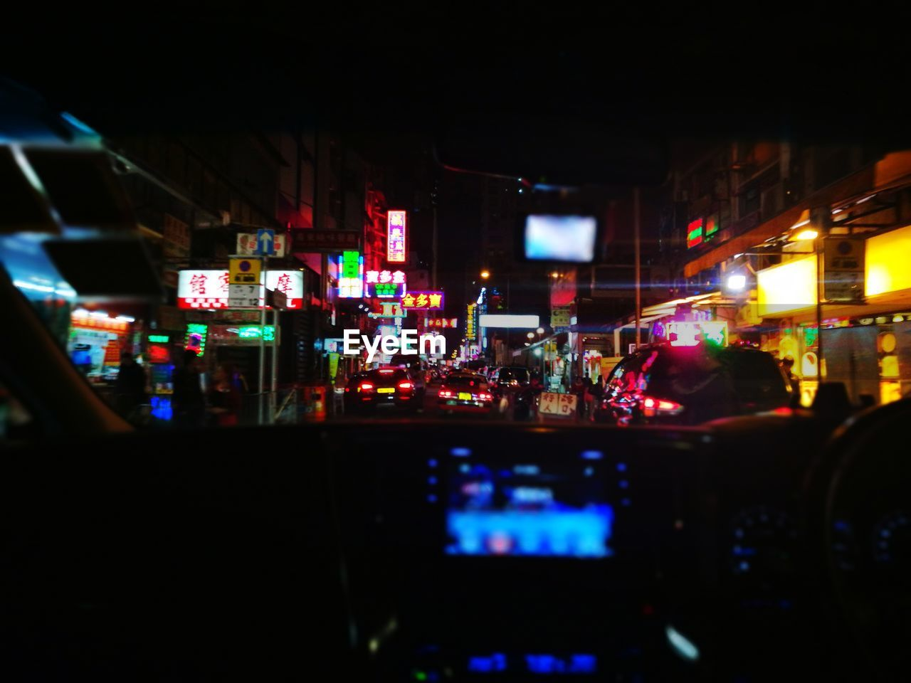 night, illuminated, city, architecture, nightlife, building exterior, built structure, lighting equipment, multi colored, mode of transportation, no people, nightclub, car, dark, transportation, arts culture and entertainment, light, motor vehicle, glowing