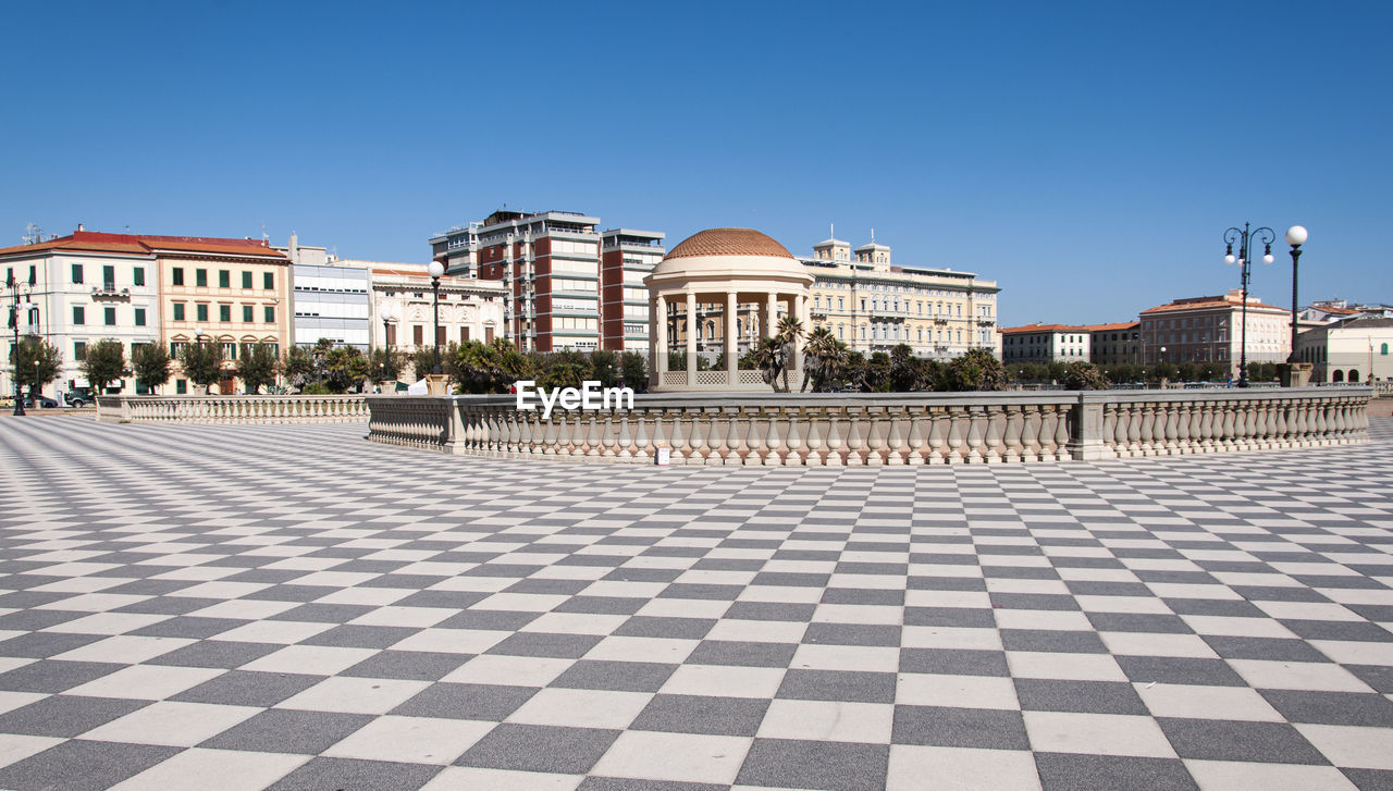 architecture, built structure, building exterior, clear sky, sky, building, checked pattern, city, nature, copy space, day, town square, pattern, blue, no people, tiled floor, flooring, tile, white color, outdoors
