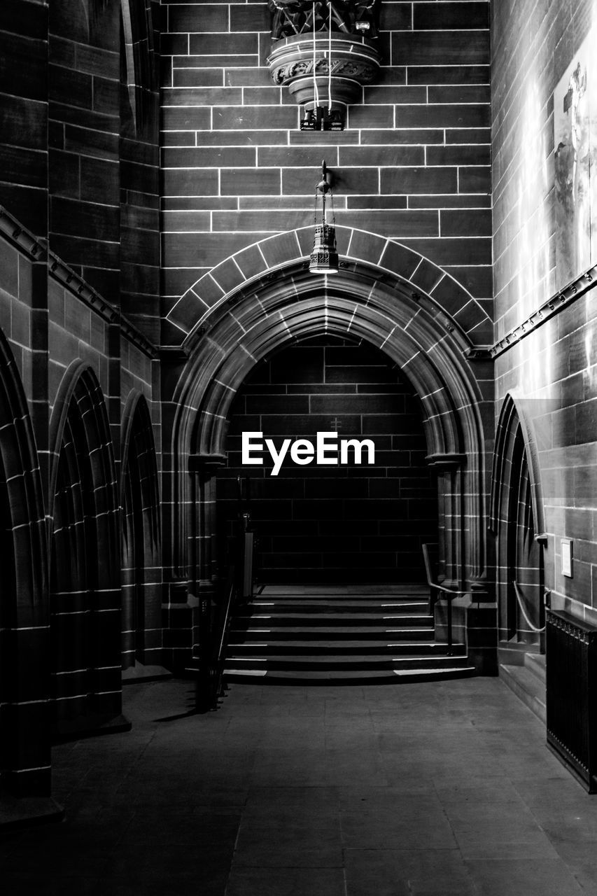 architecture, arch, built structure, indoors, building, brick, no people, staircase, wall, illuminated, brick wall, absence, empty, the way forward, direction, day, wall - building feature, entrance, lighting equipment, arched, ceiling
