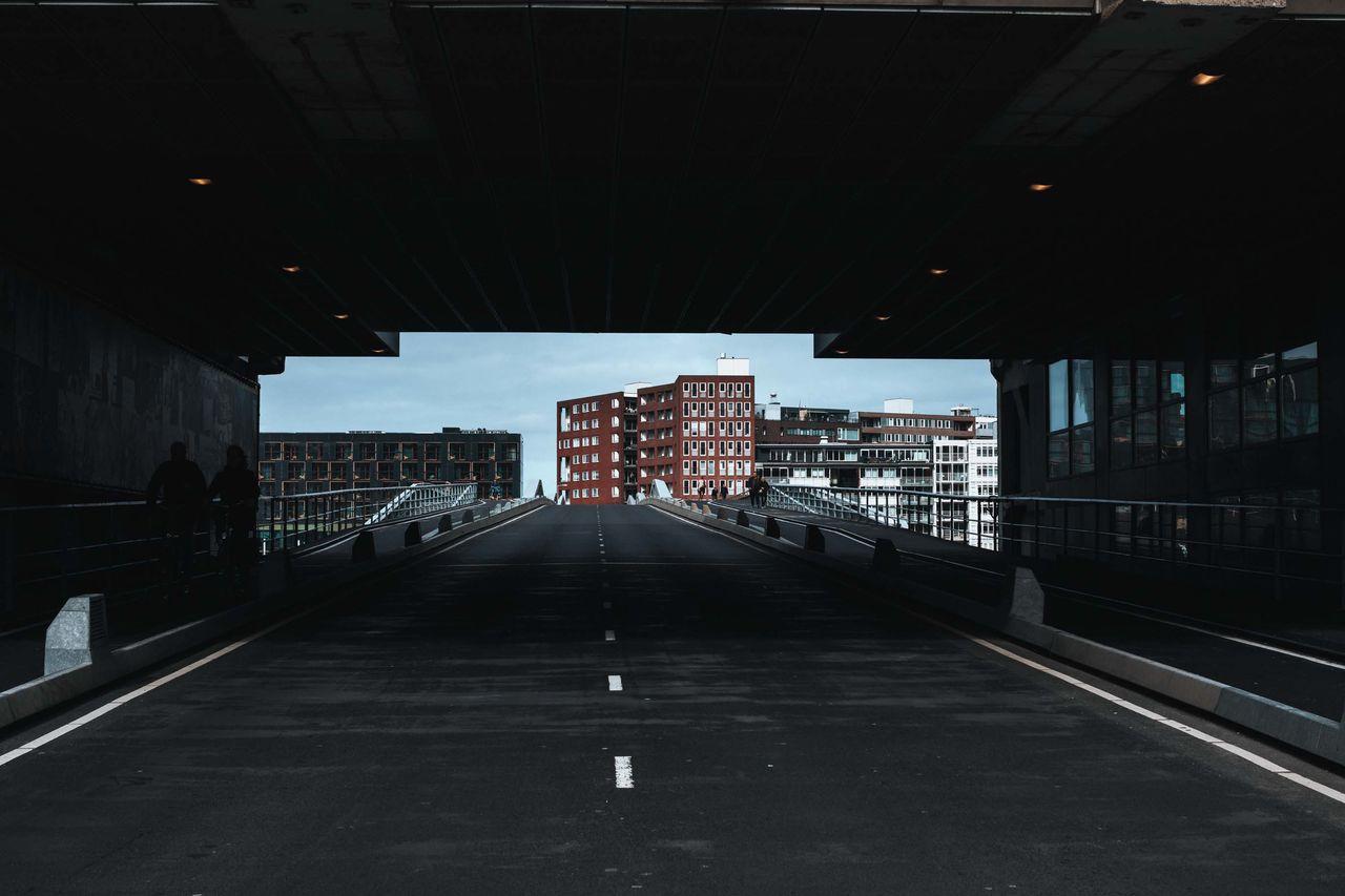 EMPTY ROAD LEADING TOWARDS BUILDINGS