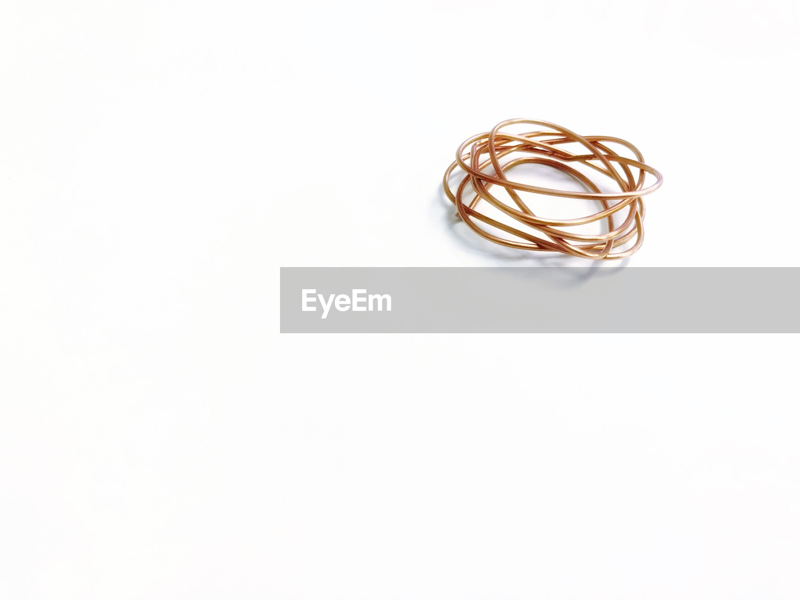 Close-up of metallic string on white background
