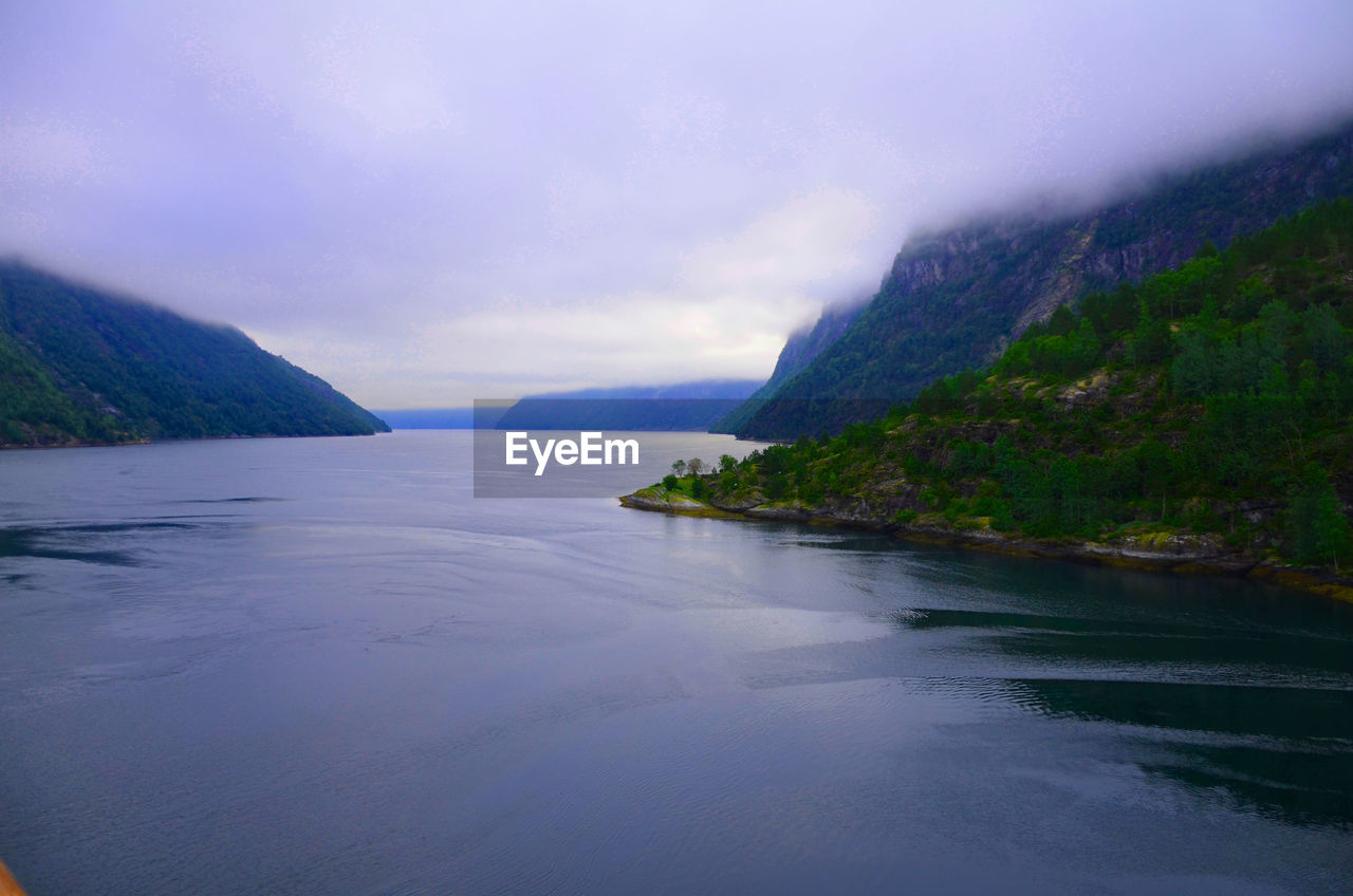 scenics, nature, beauty in nature, water, tranquil scene, sea, mountain, tranquility, sky, no people, outdoors, landscape, day