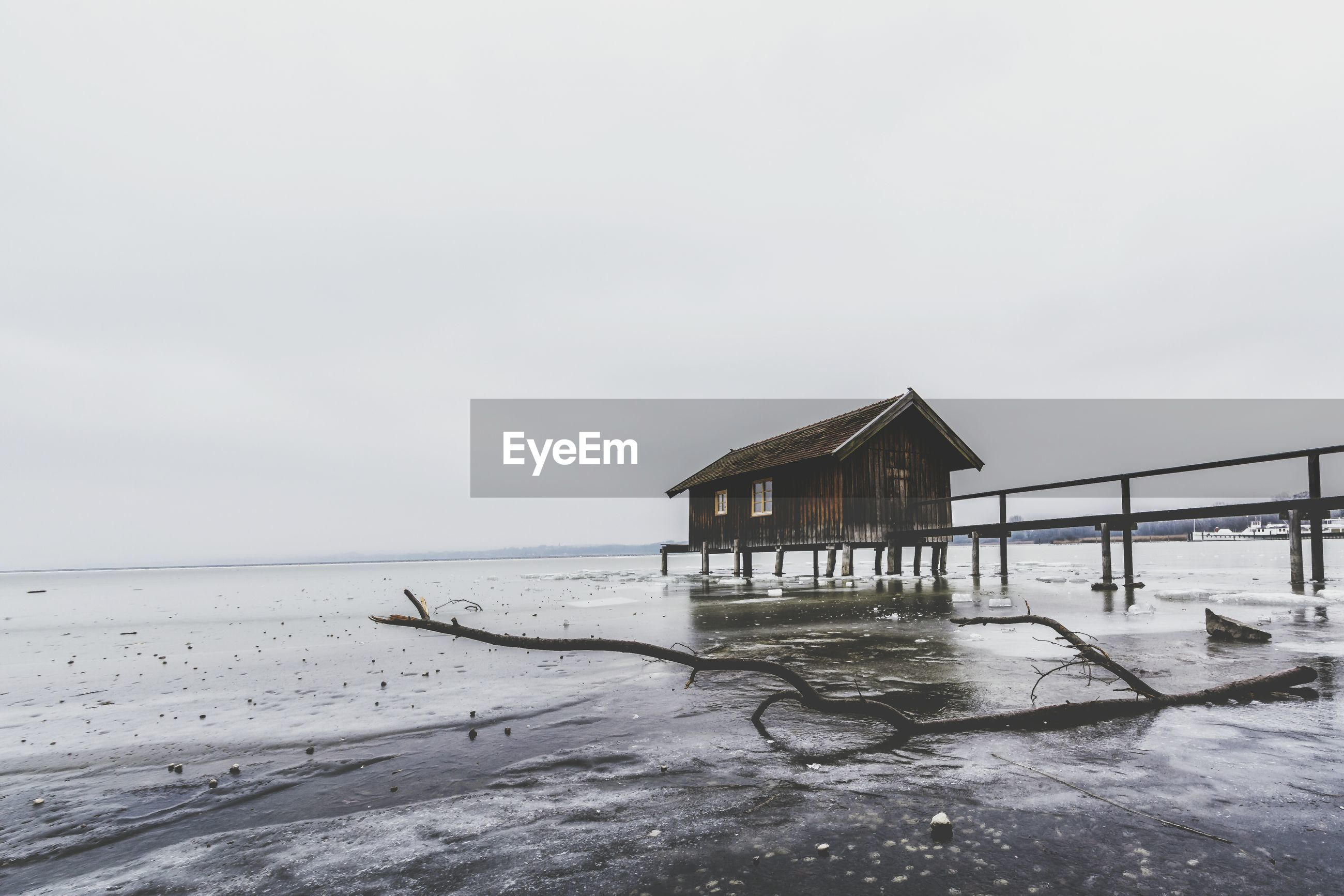 BUILT STRUCTURE ON BEACH DURING WINTER