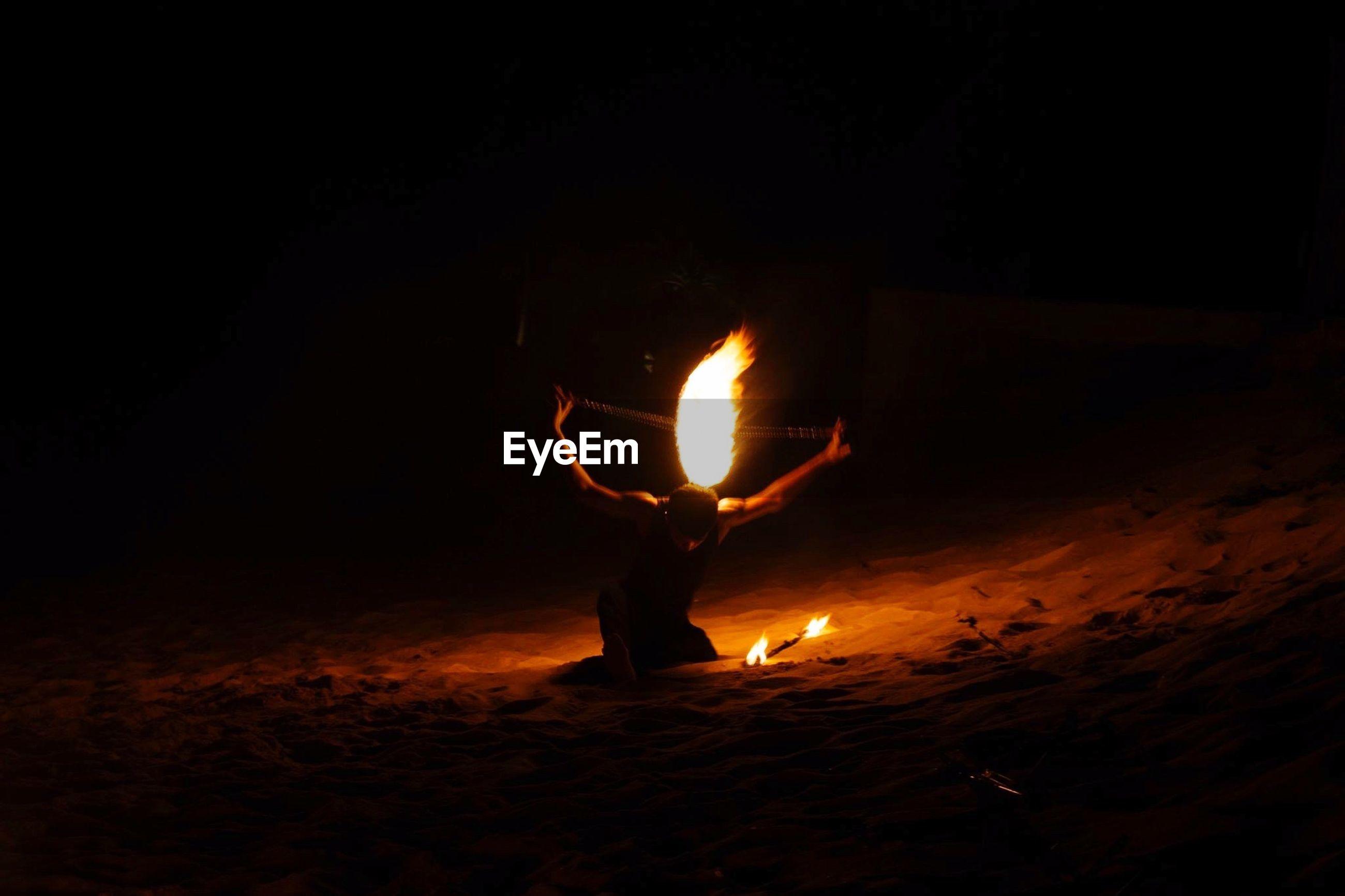 burning, flame, fire - natural phenomenon, heat - temperature, night, men, lifestyles, leisure activity, fire, silhouette, glowing, bonfire, dark, illuminated, standing, heat, holding, campfire