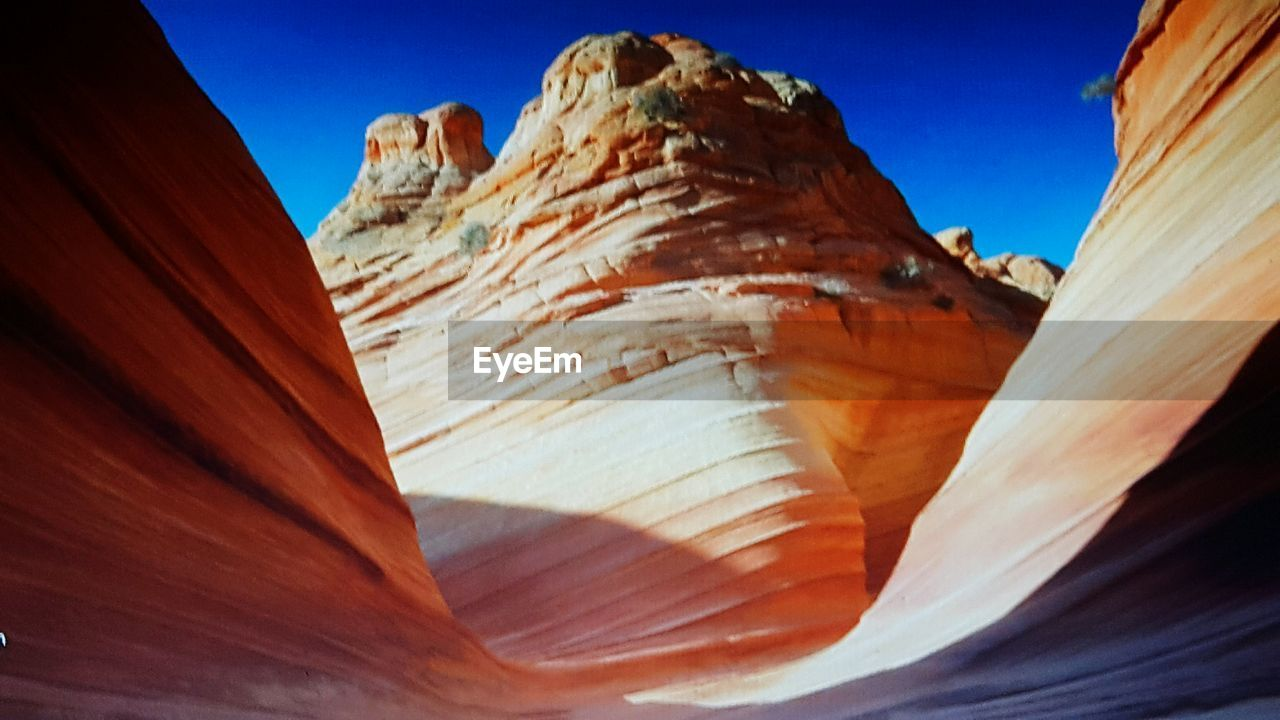 geology, rock - object, rock formation, nature, no people, mountain, day, physical geography, beauty in nature, outdoors, tranquility, landscape, sunlight, desert, scenics, clear sky, close-up, sky