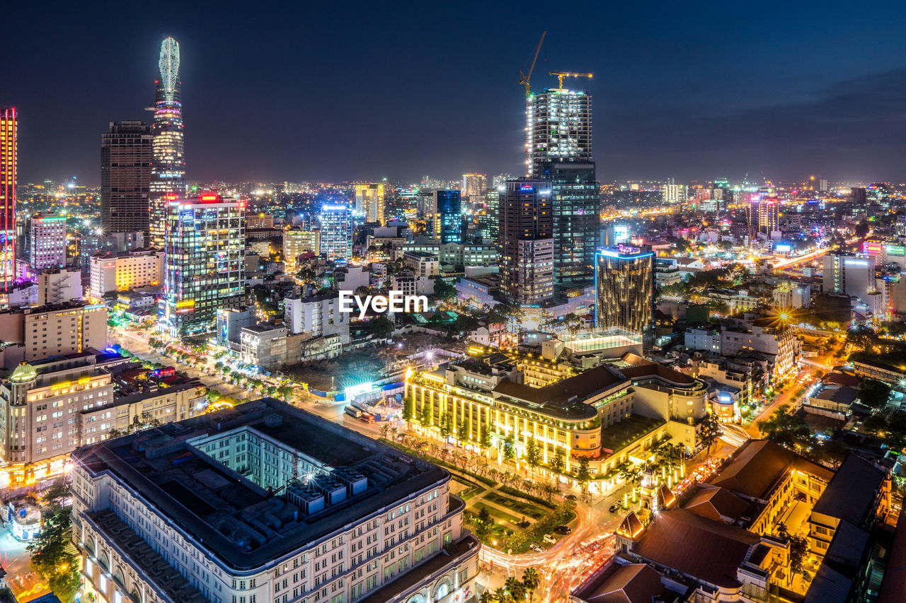 architecture, building exterior, illuminated, built structure, city, building, cityscape, night, office building exterior, skyscraper, sky, modern, tower, tall - high, landscape, no people, city life, urban skyline, travel destinations, outdoors, financial district, spire