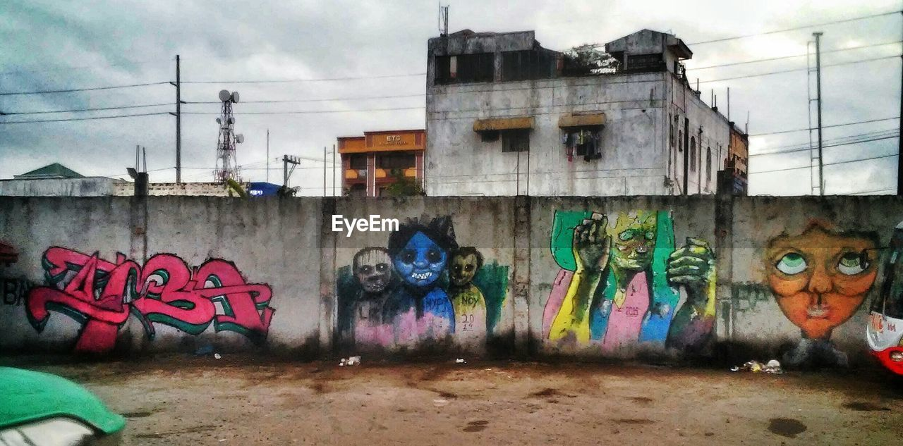 graffiti, creativity, art and craft, architecture, street art, built structure, wall - building feature, building exterior, day, multi colored, outdoors, no people, sky, city
