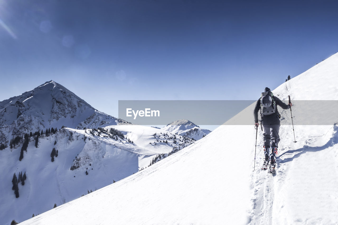 snow, cold temperature, winter, mountain, scenics - nature, beauty in nature, snowcapped mountain, sky, sport, white color, adventure, leisure activity, day, mountain range, environment, nature, winter sport, tranquil scene, non-urban scene, outdoors, extreme weather