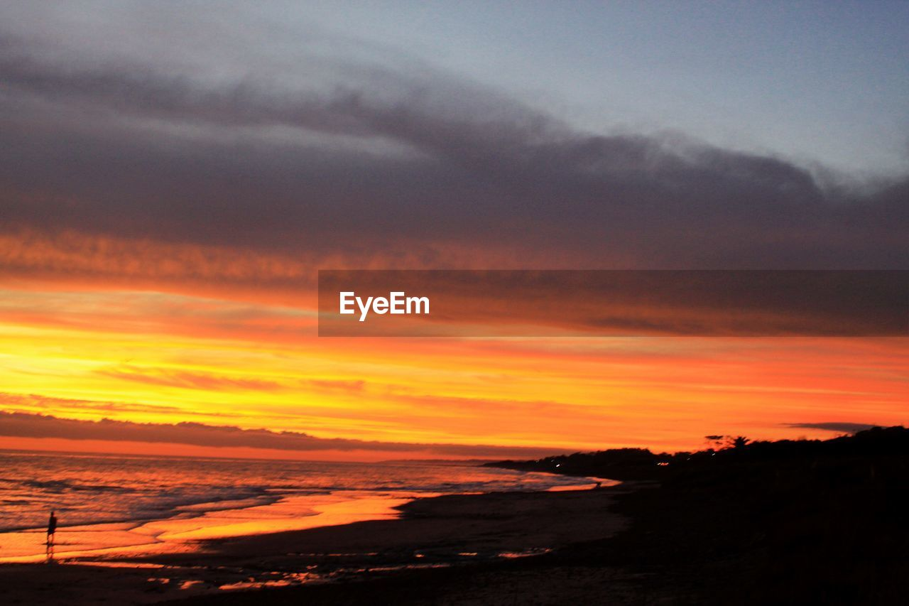 sunset, sky, cloud - sky, beauty in nature, scenics - nature, orange color, tranquility, tranquil scene, idyllic, nature, no people, silhouette, dramatic sky, outdoors, sea, environment, horizon, water, romantic sky