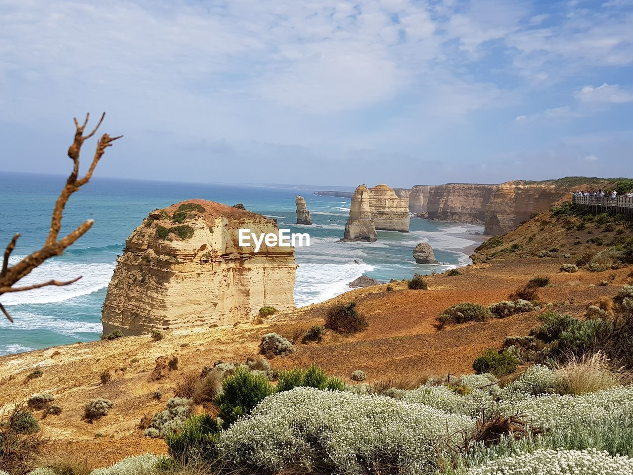 SCENIC VIEW OF SEA AGAINST ROCK FORMATION