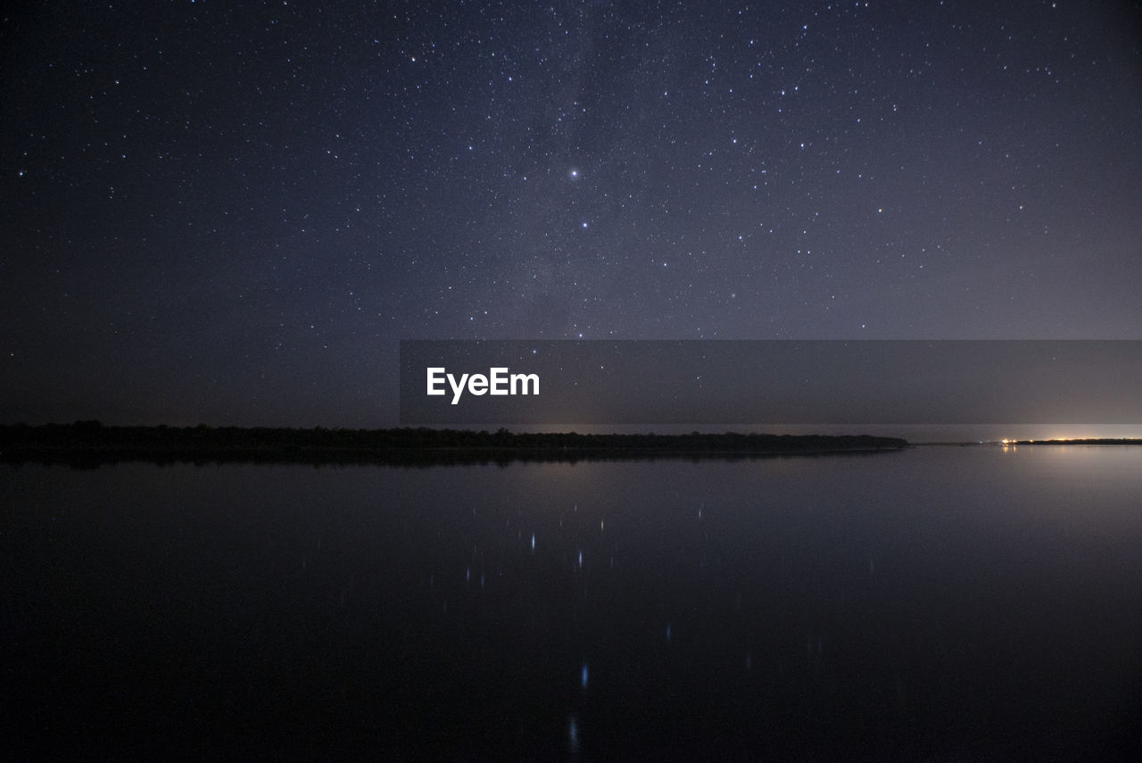 night, sky, water, star - space, scenics - nature, astronomy, tranquility, tranquil scene, beauty in nature, space, waterfront, lake, star, reflection, galaxy, nature, idyllic, star field, no people, outdoors, space and astronomy