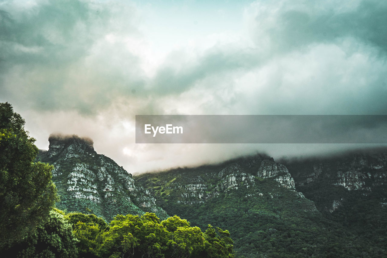 cloud - sky, mountain, sky, beauty in nature, scenics - nature, tranquil scene, nature, tranquility, tree, plant, no people, non-urban scene, day, environment, mountain range, landscape, outdoors, overcast, idyllic, formation