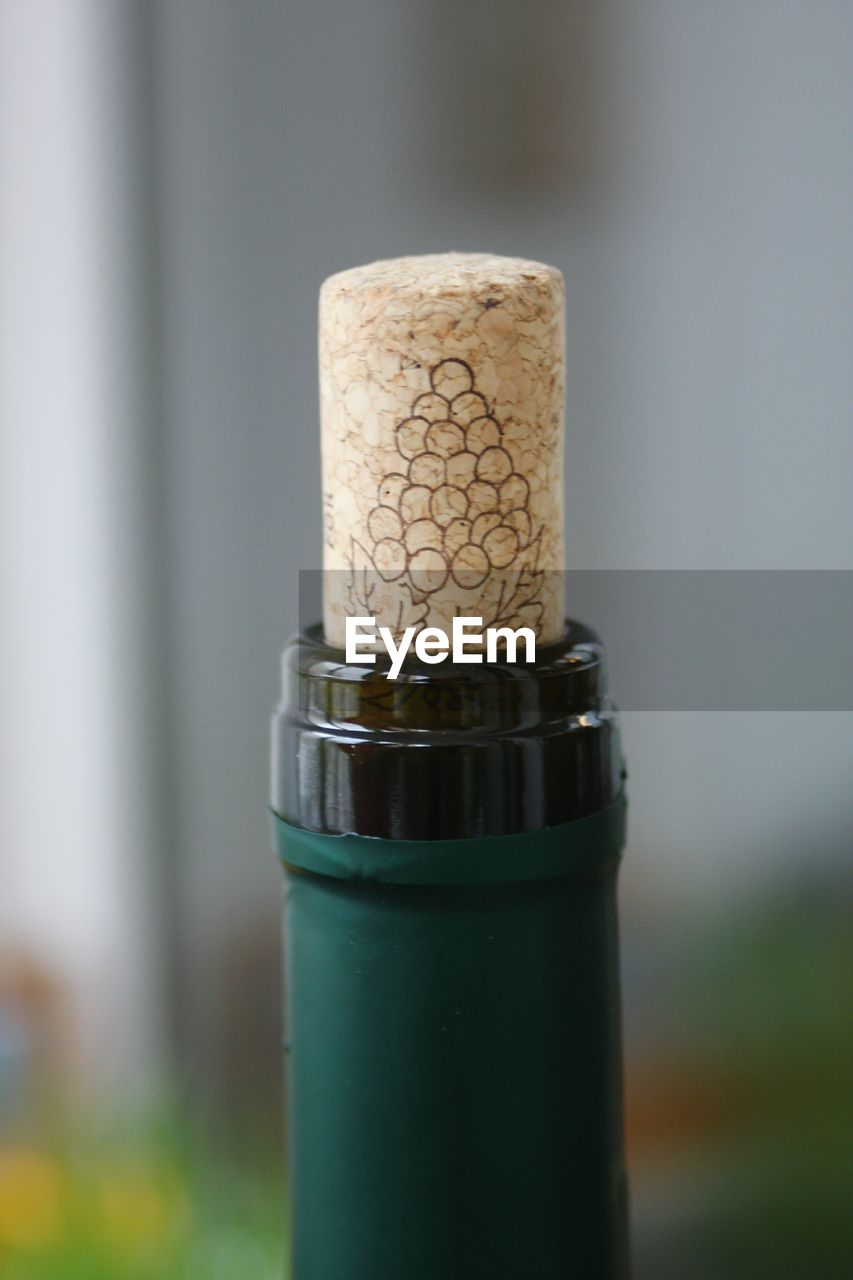 cork - stopper, close-up, focus on foreground, wine cork, no people, container, wine bottle, indoors, food and drink, bottle, still life, wine, drink, refreshment, wood - material, alcohol, day, corkscrew, selective focus, glass - material