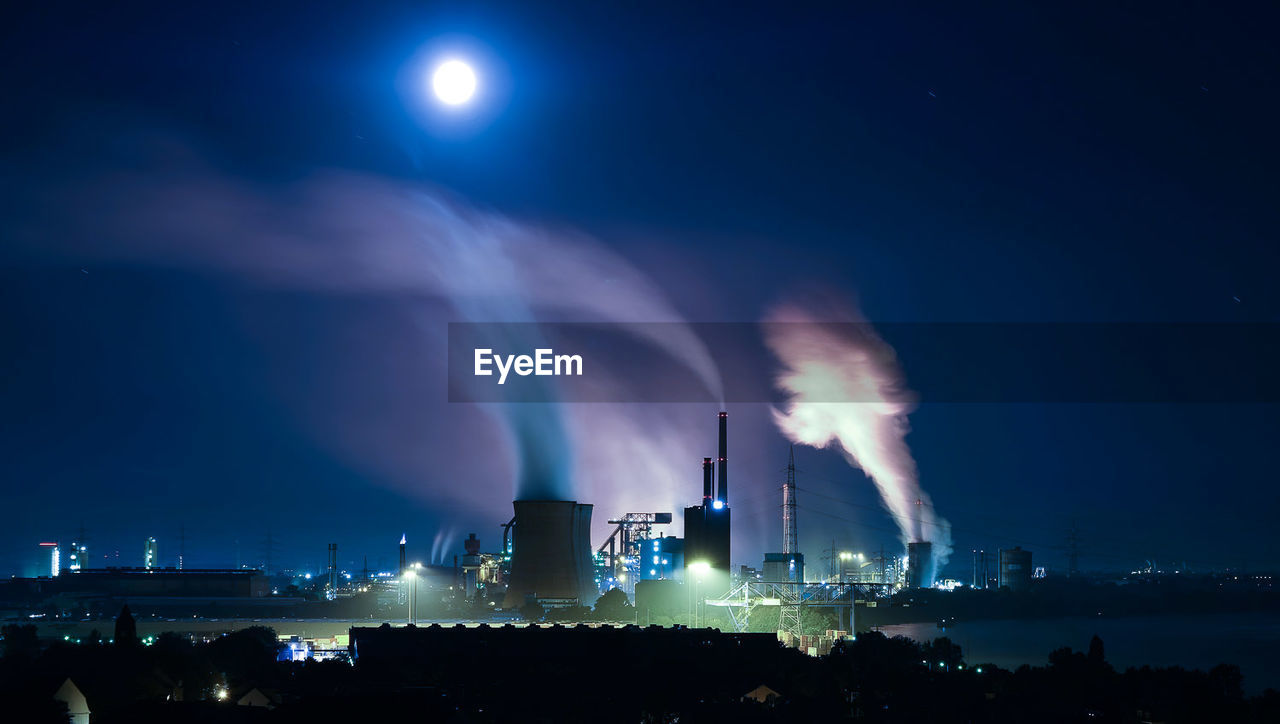 Smoking Emanating From Chimneys Of Industry At Night