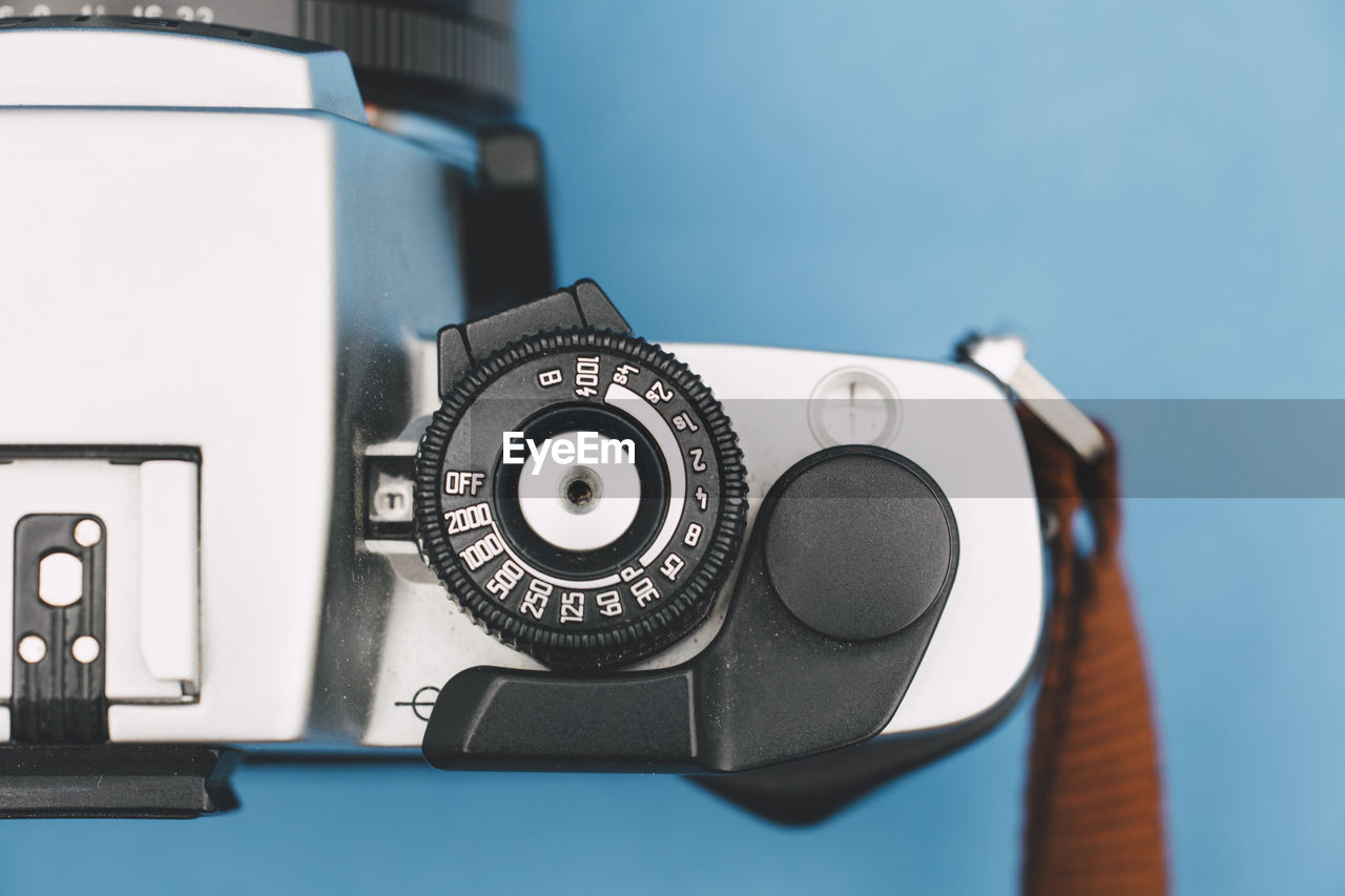 Close-up of camera on blue background