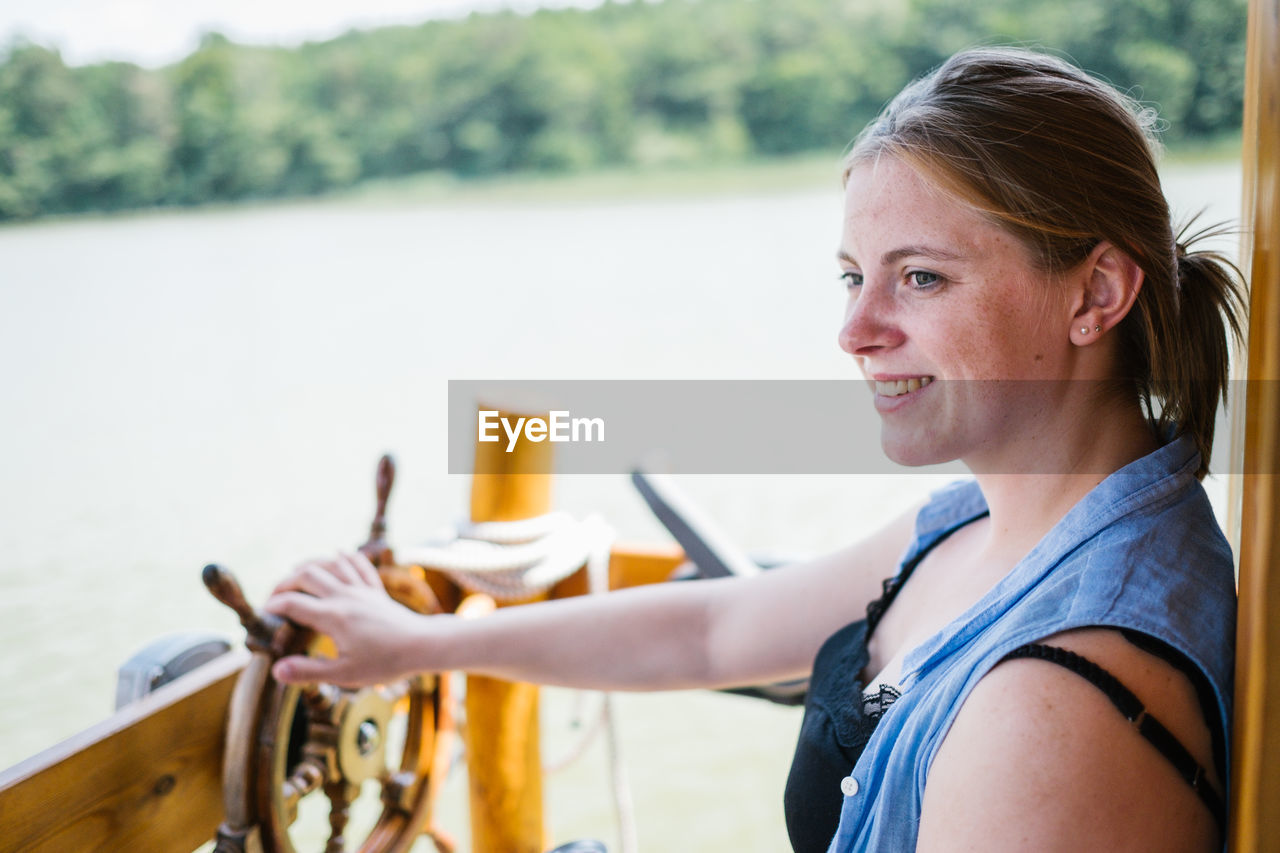 Side View Of Smiling Woman In Boat
