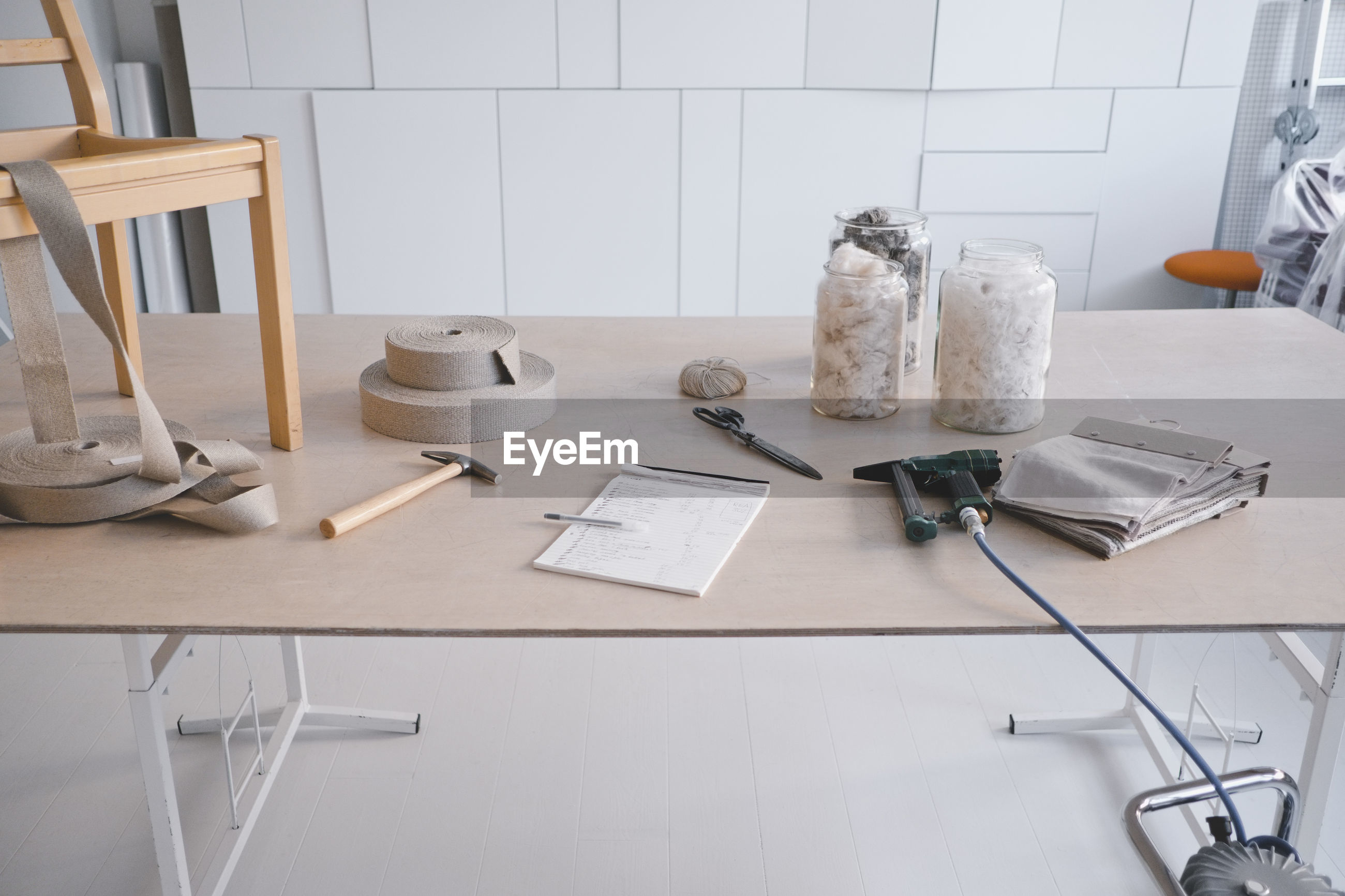 HIGH ANGLE VIEW OF PEN AND TABLE ON FLOOR AT HOME
