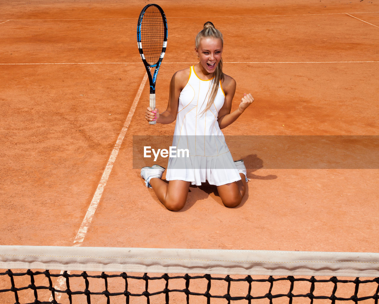 tennis, racket, tennis racket, sport, court, one person, tennis ball, women, tennis net, young adult, clothing, playing, front view, ball, young women, motion, adult, holding